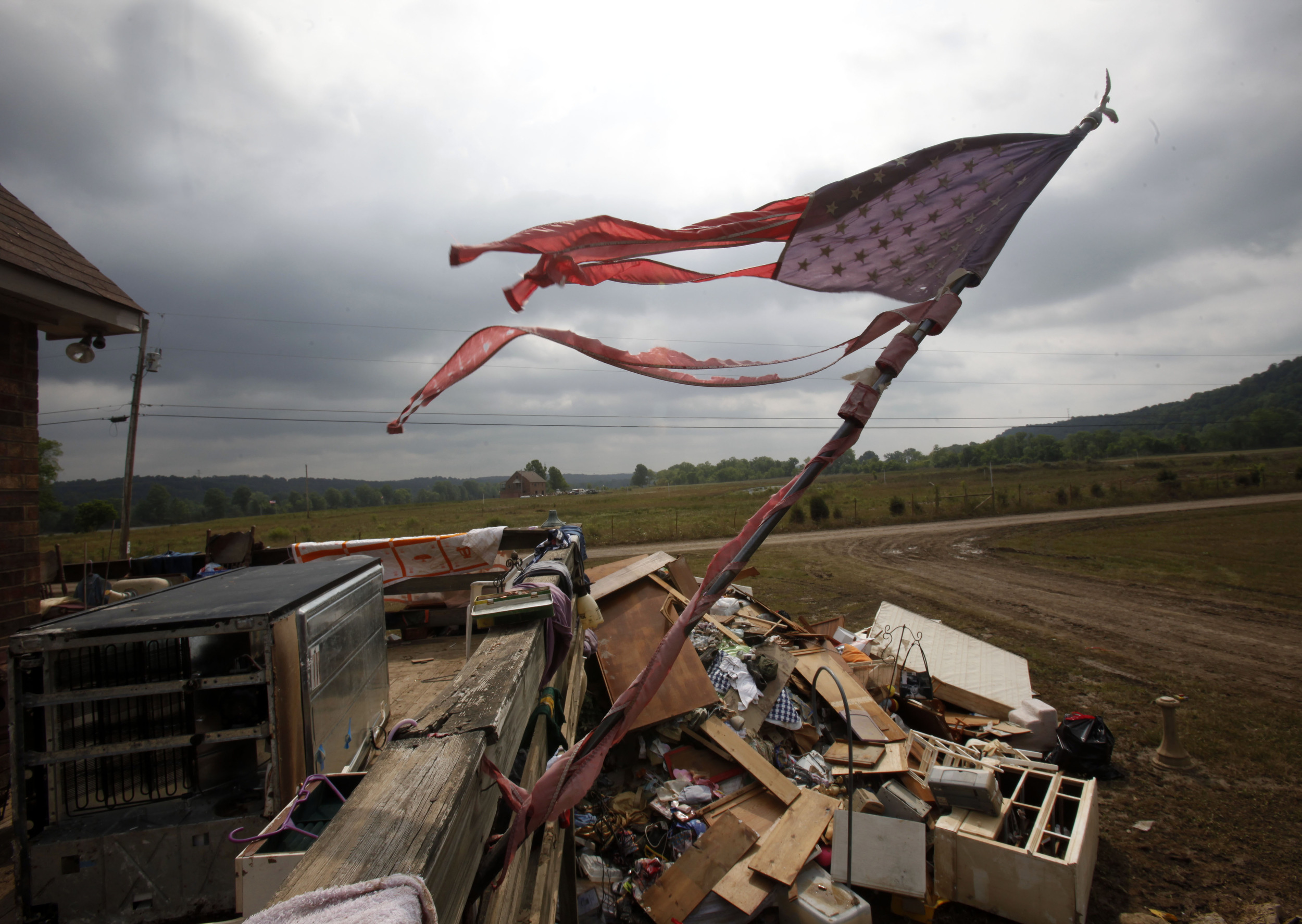 A flag is in tatters amidst wreckage after the historic 2010 flood inundated this floodplain along the Cumberland river near Ashland City, Tenn.