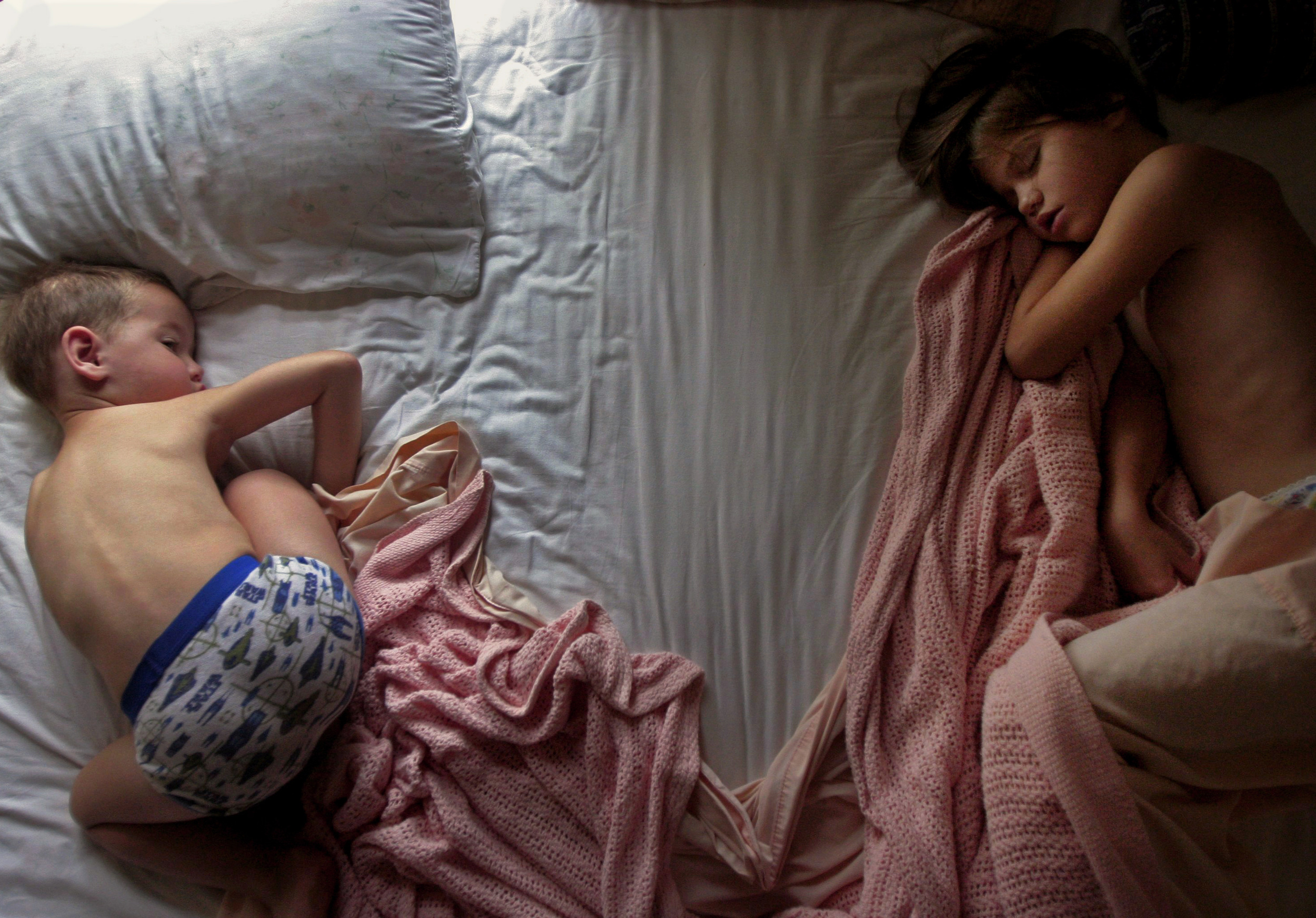 Anna Stewart Burdette and her brother Tibor wake up in the morning light in their parents' bed.