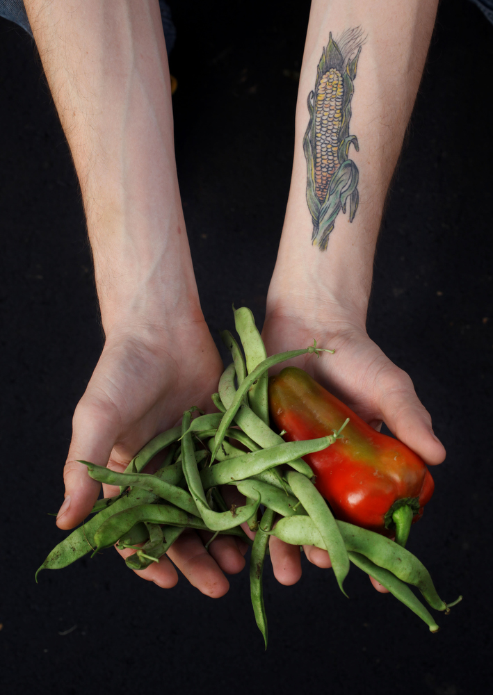 Self-described foodie Andy Brubaker displays his cornstalk tattoo on his forearm at the East Nashville Farmers market in Nashville, Tenn.