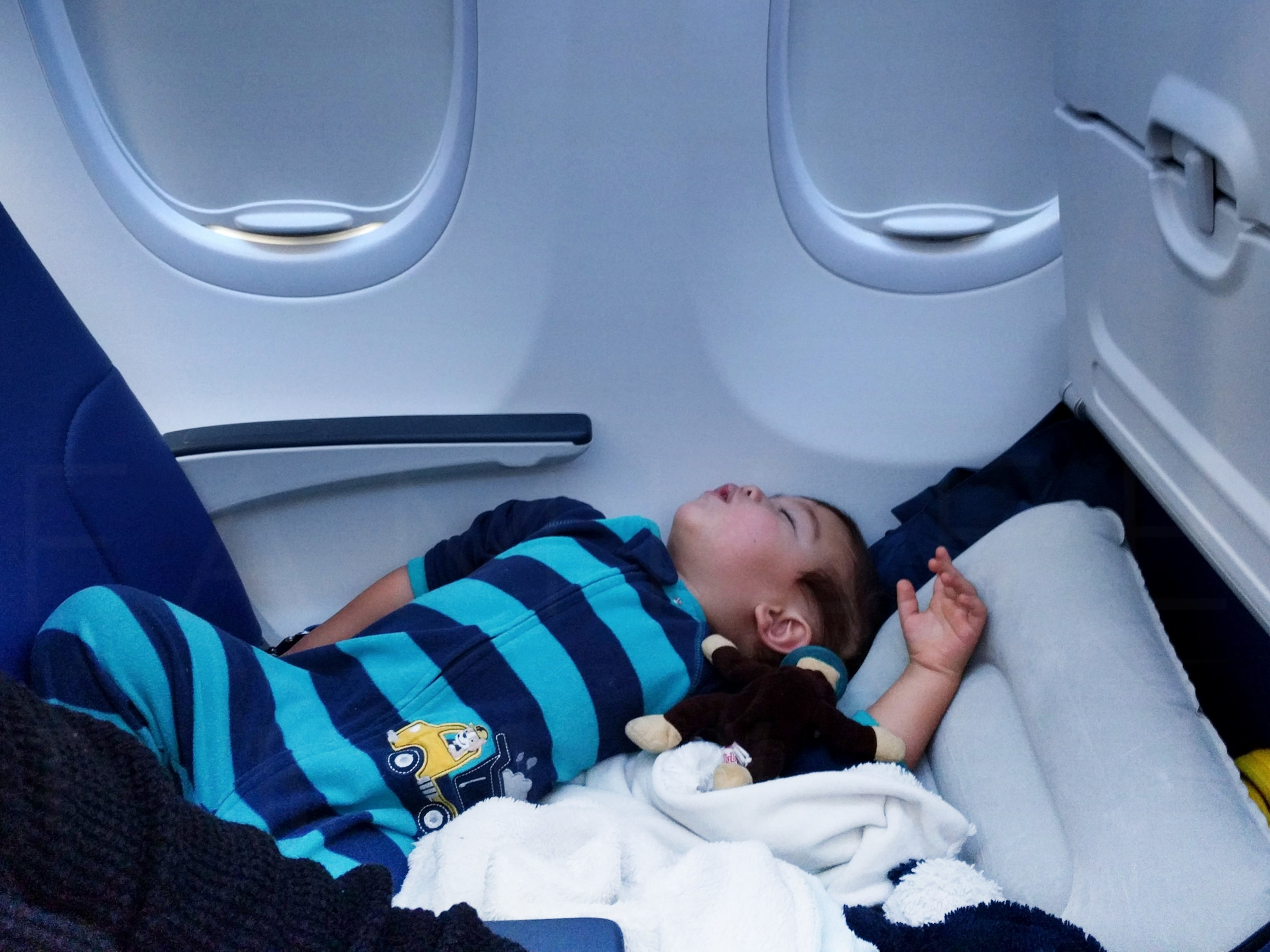 Elden (22 months old) using Fly LegsUp to sleep on the plane