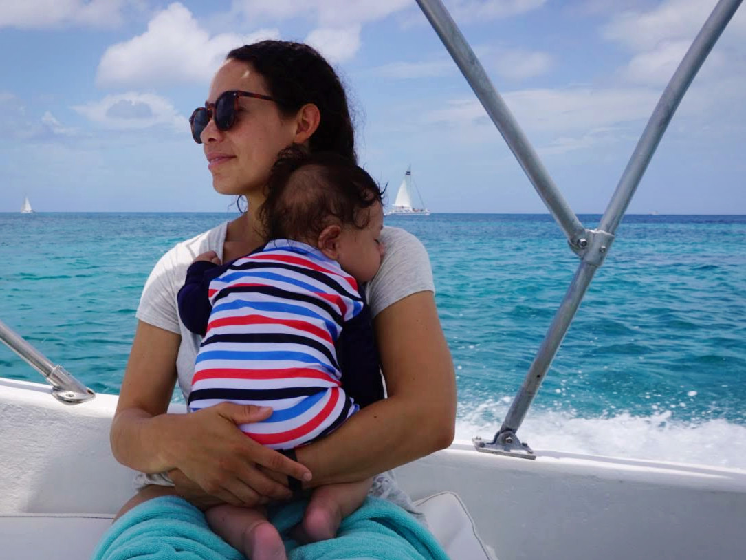 Orlo (4 months old) taking a nap on our boat ride off of Cozumel, Mexico