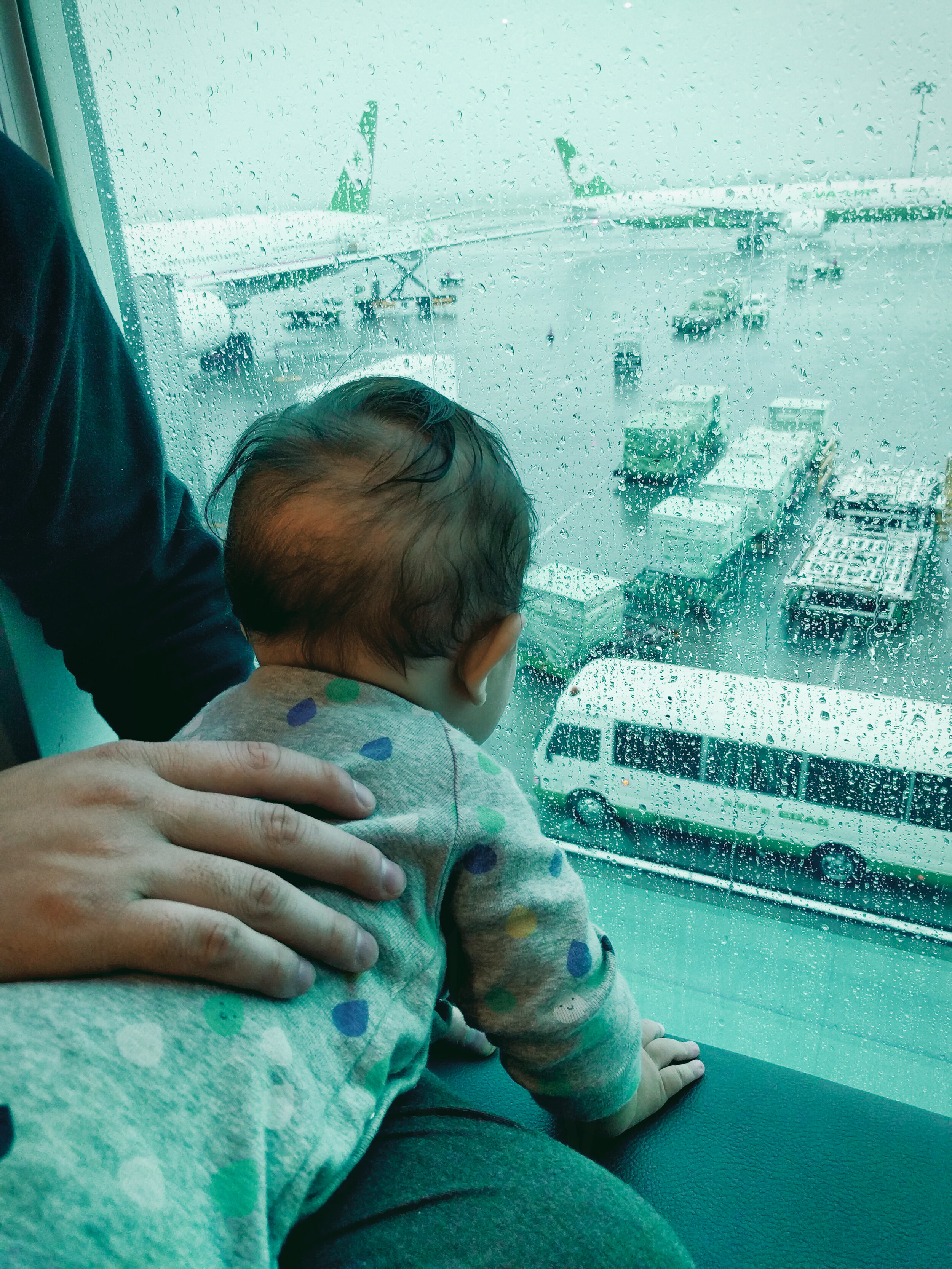 Elden (7 months old) watching the planes and ground crew