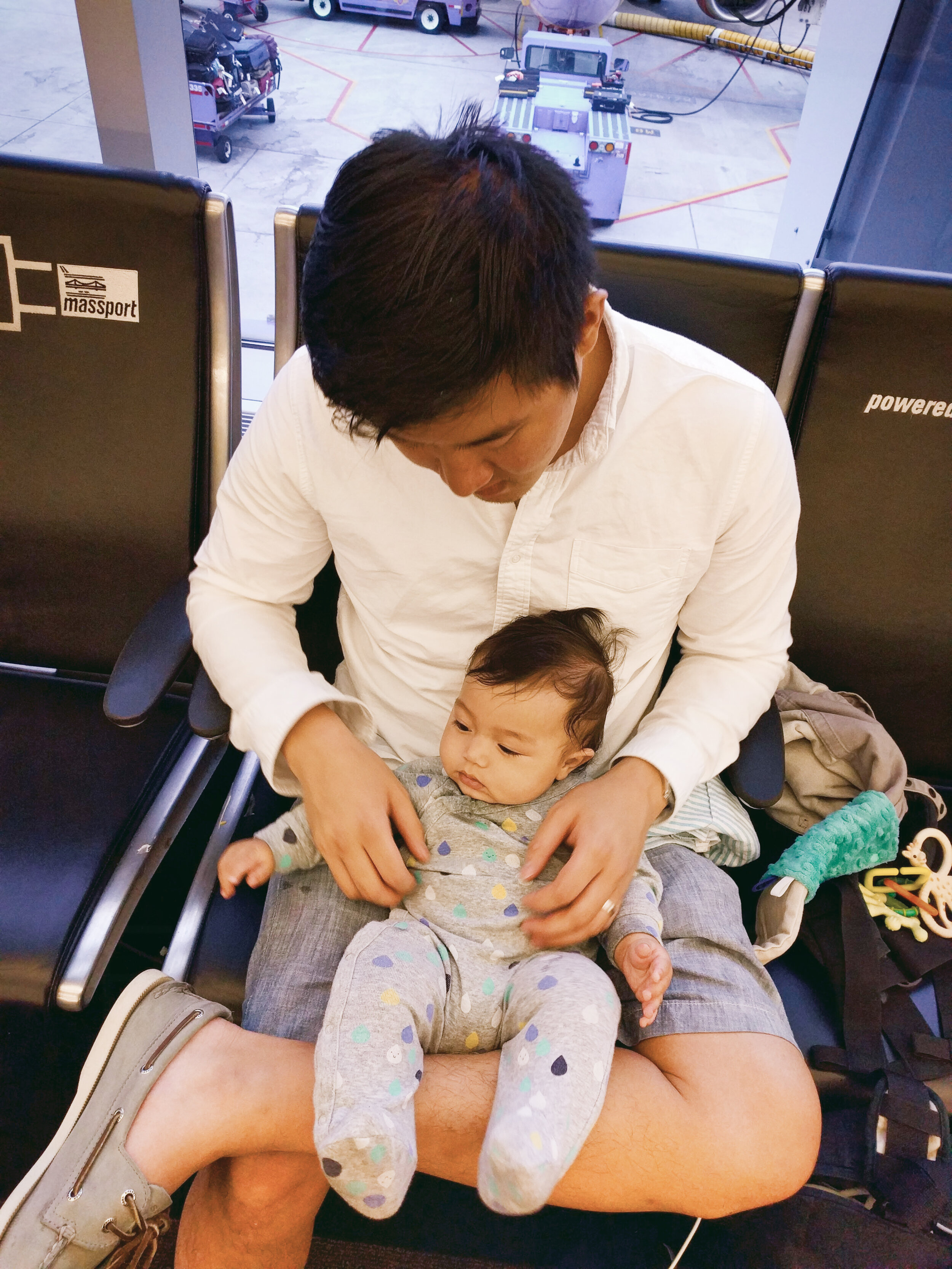 Steve and Elden (5 months old) waiting to board a flight out of BOS