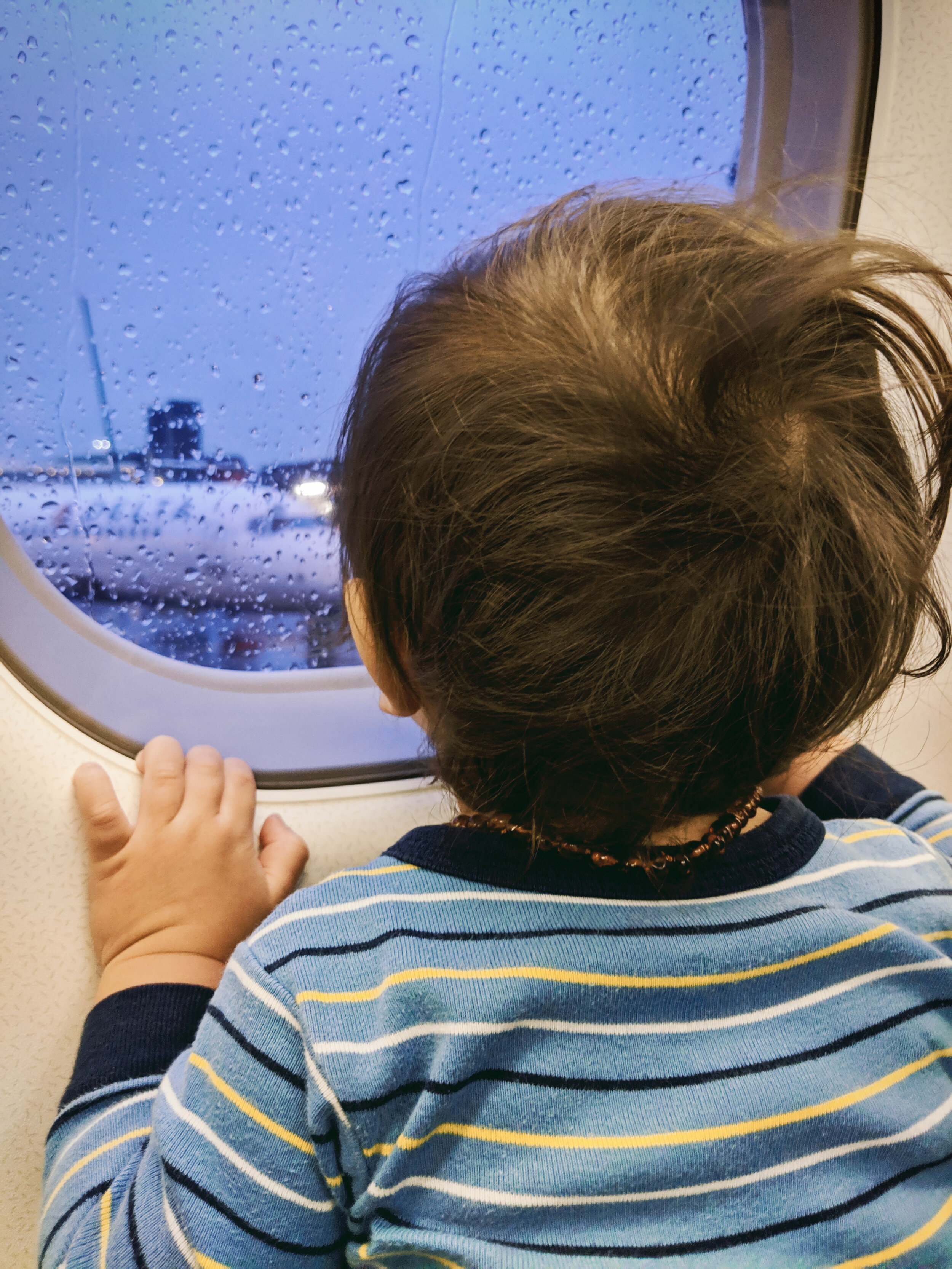 Watching the planes on a rainy flight day