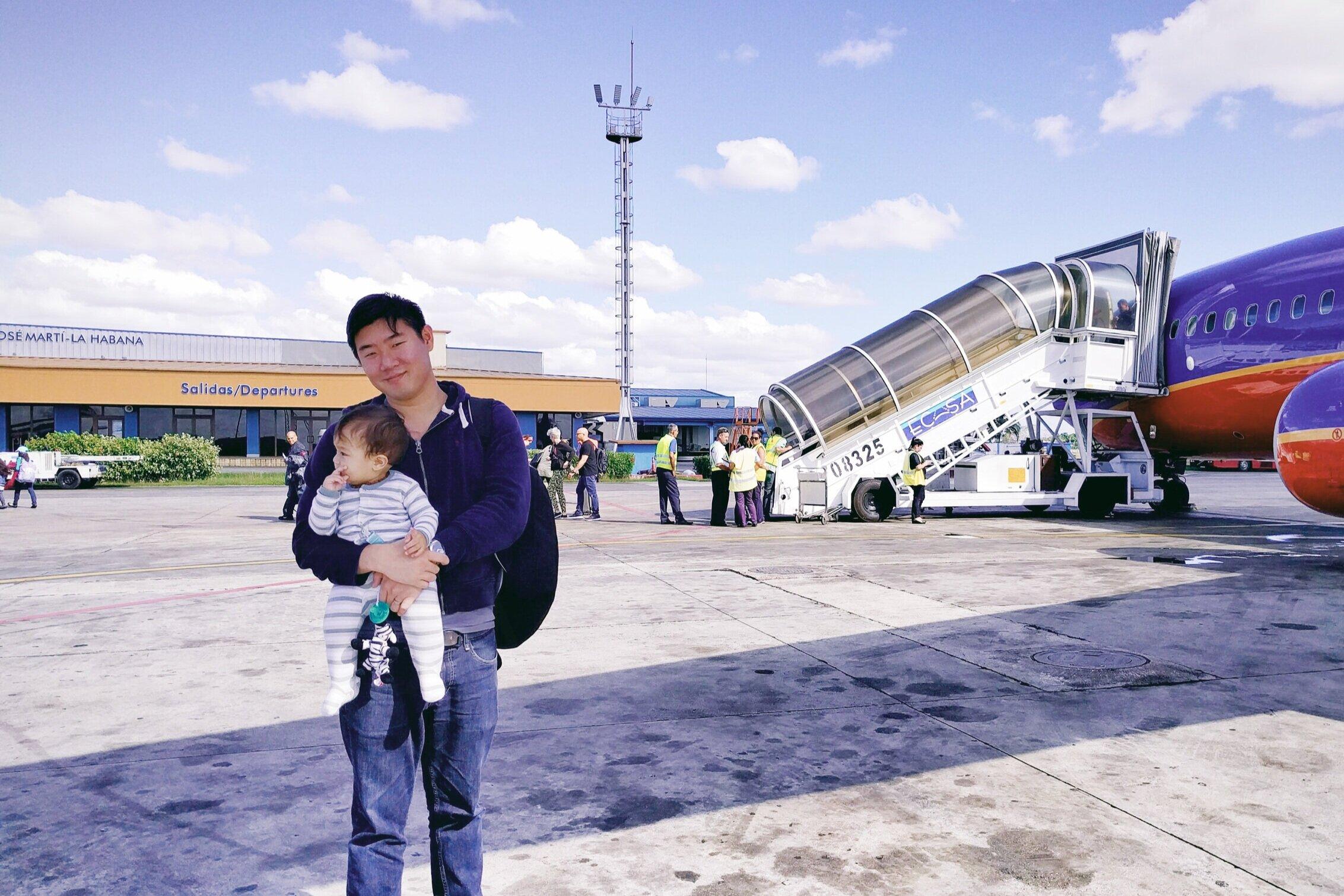 Steven and Elden (10 months old) after landing in Cuba