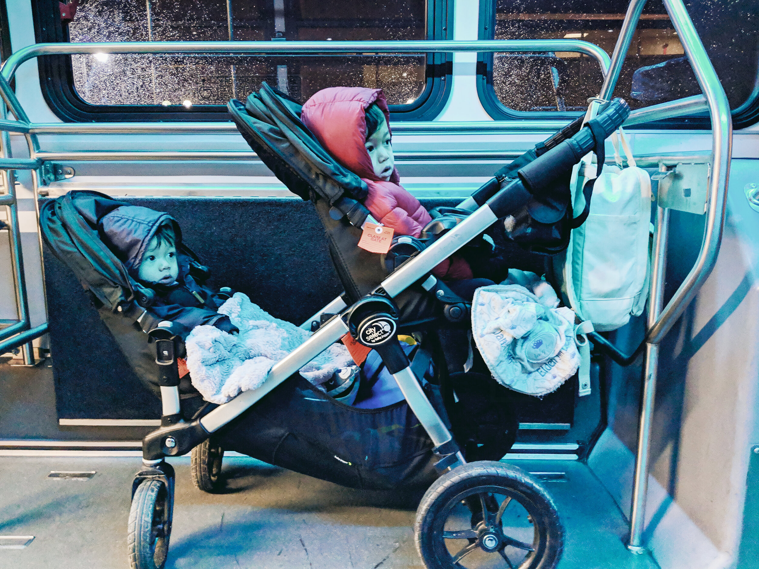 Double stroller on the airport shuttle from the parking garage to airport
