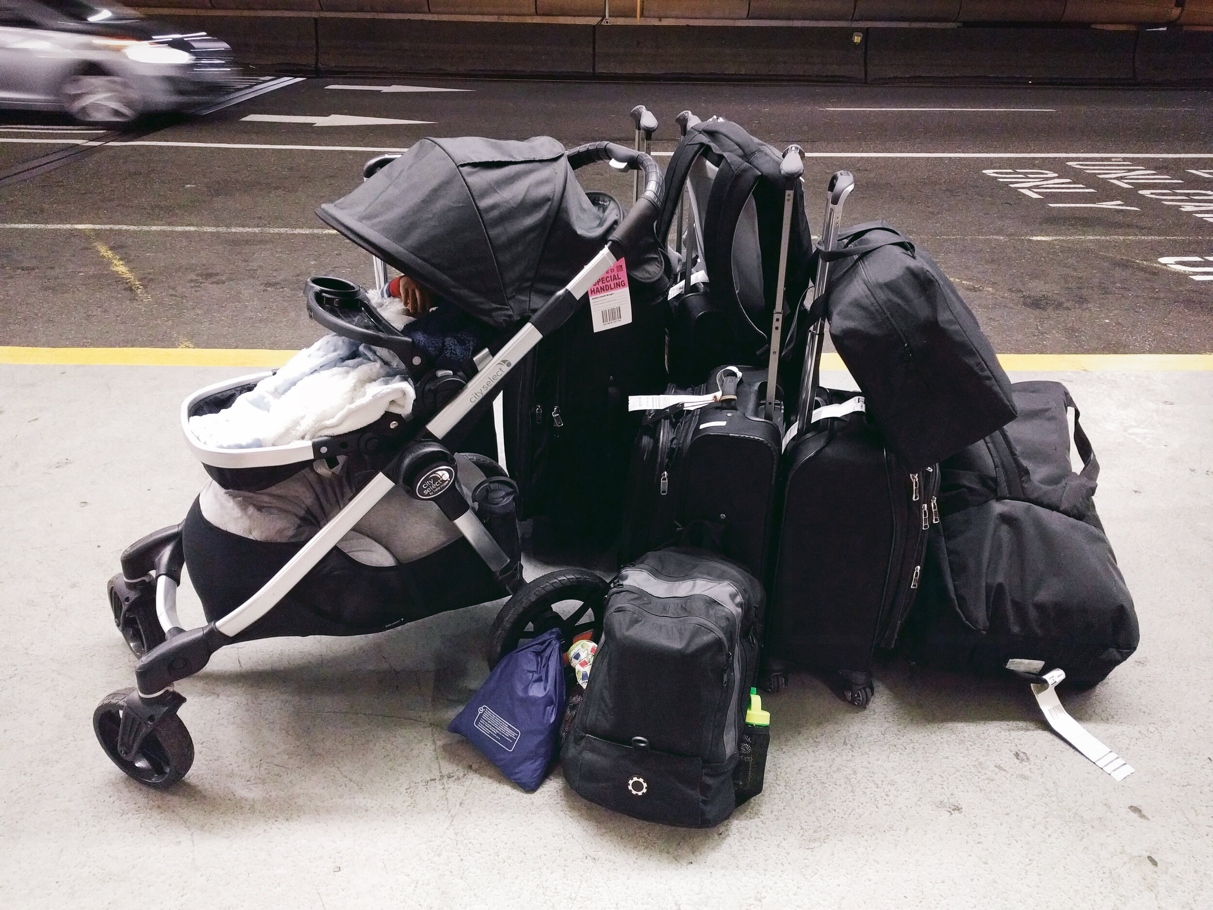 The opposite of packing minimally, what it looks like when you move cross country with a baby (Pictured: Travelpro suitcases, DadGear diaper backpack, J.L. Childress car seat bag, Lotus travel crib and more)