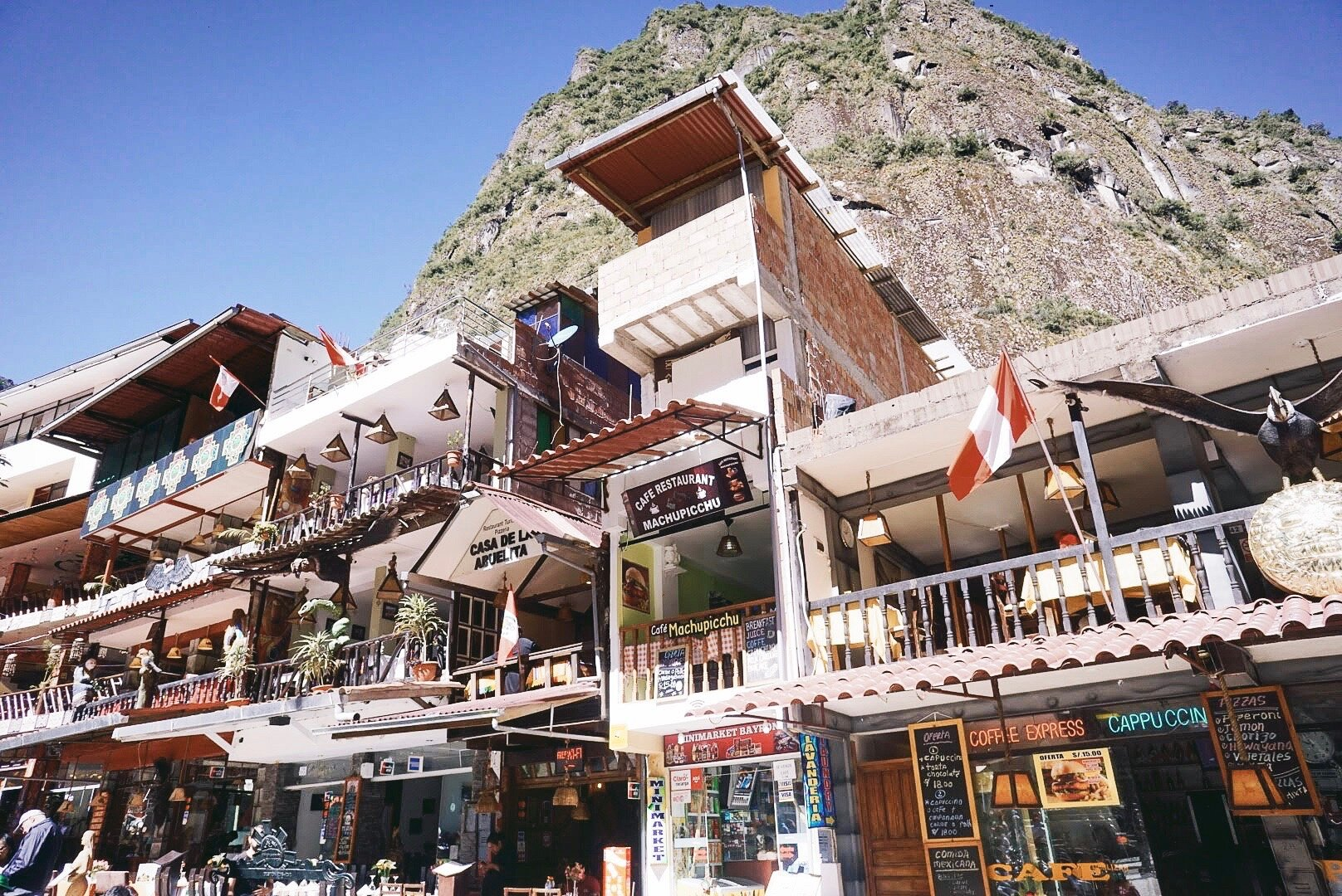 Shops, restaurants and hostels in Aguas Calientes main plaza
