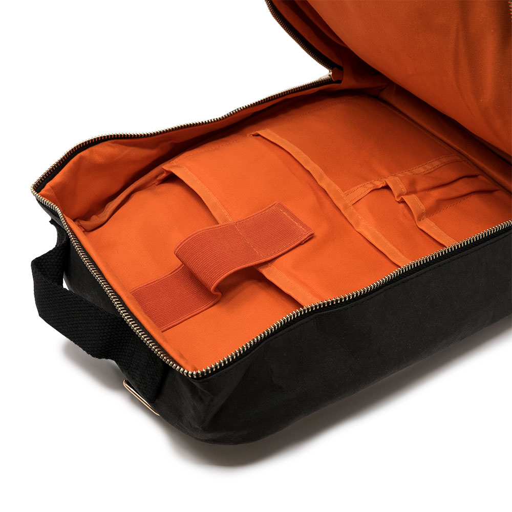 """Inside - - Organic cotton lining- 13.3-15.6"""" laptop compartment with velcro- Stationery holders- Sketchbook holder- Wide zip for easy access"""