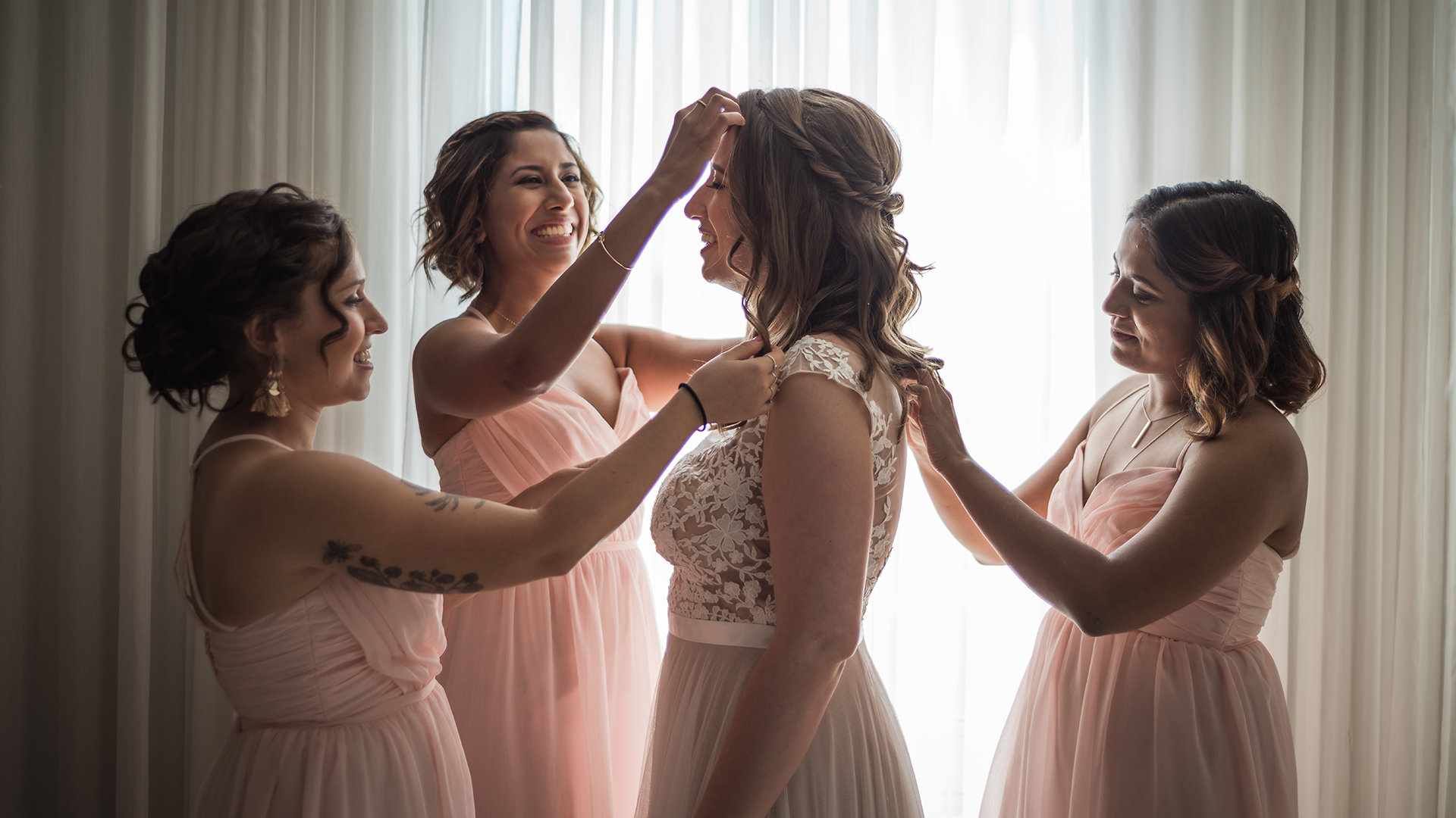 The bridesmaids making sure that everything is perfect for the bride's special day.  The Modern Honolulu in Waikiki, Hawaii