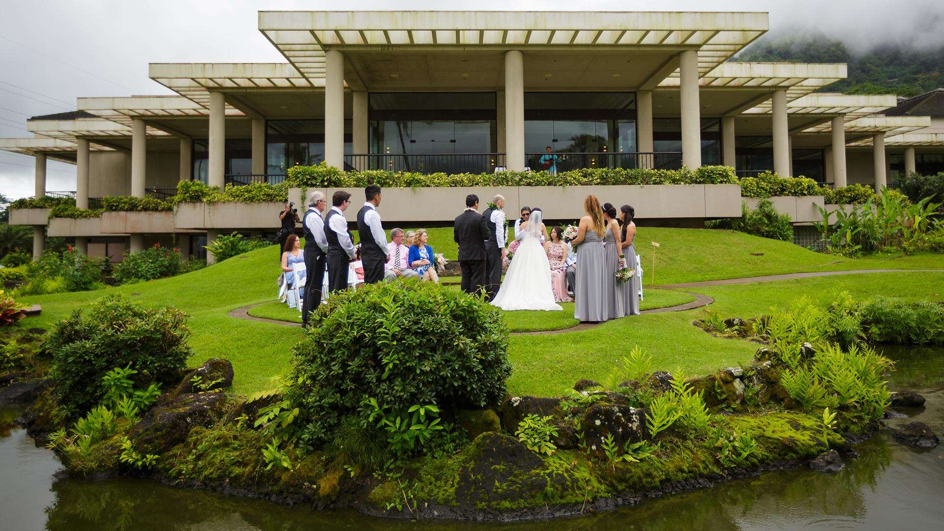 Wedding ceremony at the Koolau Ballroom's Outdoor Garden in Hawaii.
