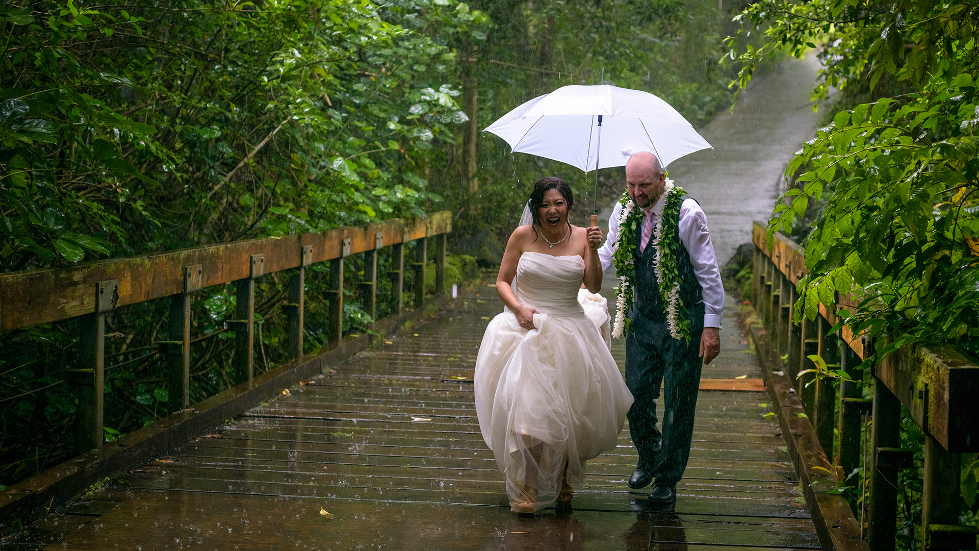 The rain didn't spoil their fun during our couple's session at the Koolau ballroom's in Hawaii.