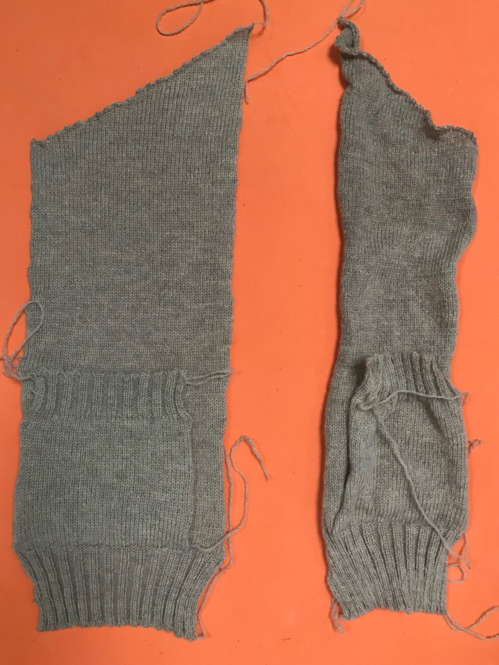 Two front pieces for a cardigan - the one on the left has been blocked into shape.