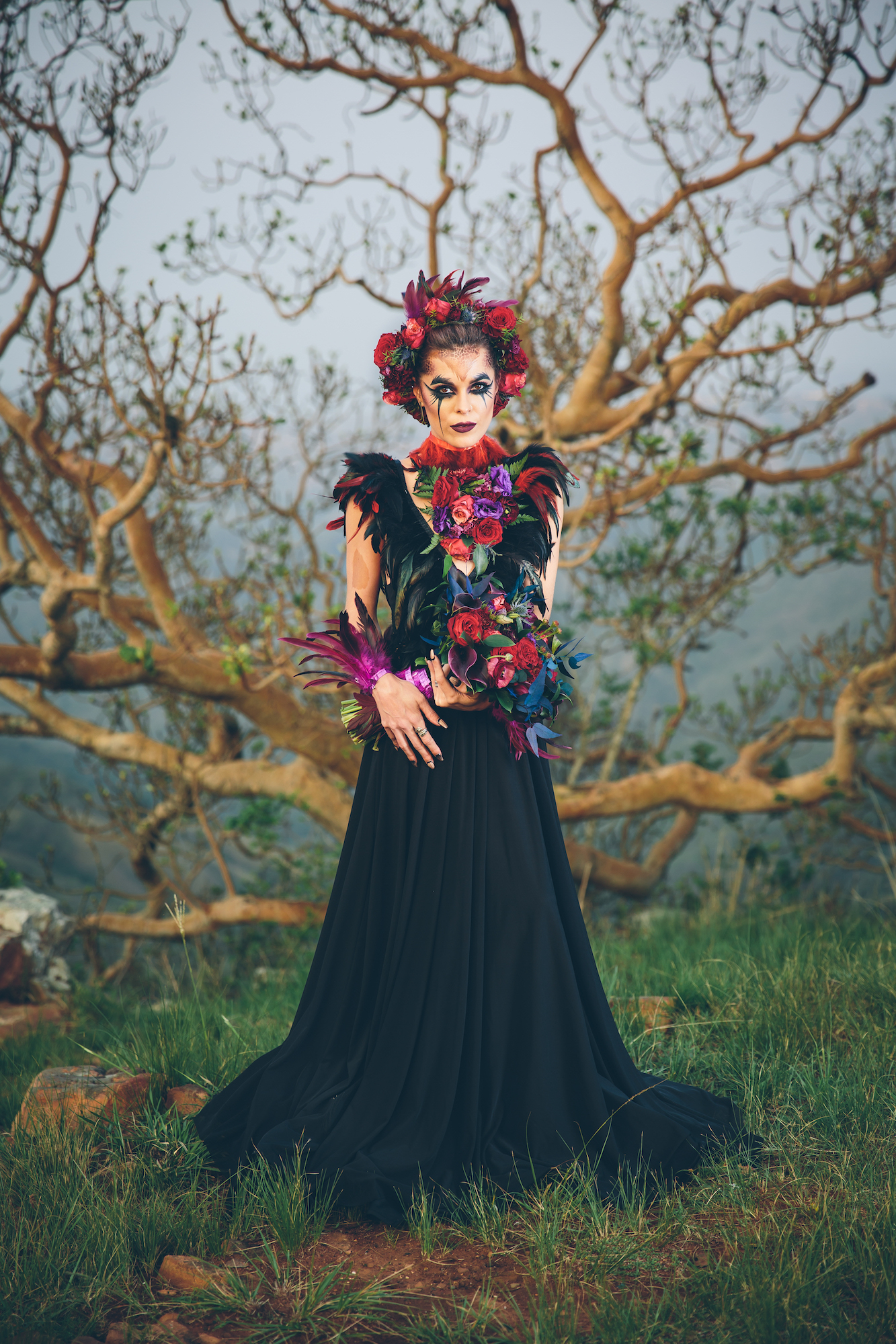 black wedding dress flowers feathers dramatic makeup halloween bride styled shoot