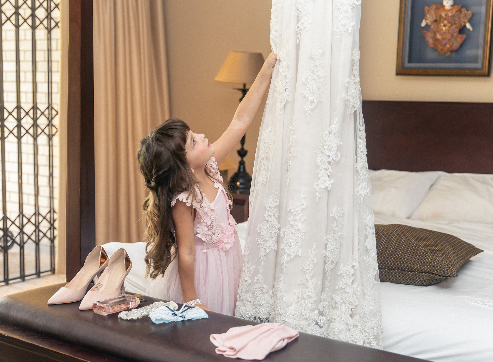 girl playing with her mom's wedding dress