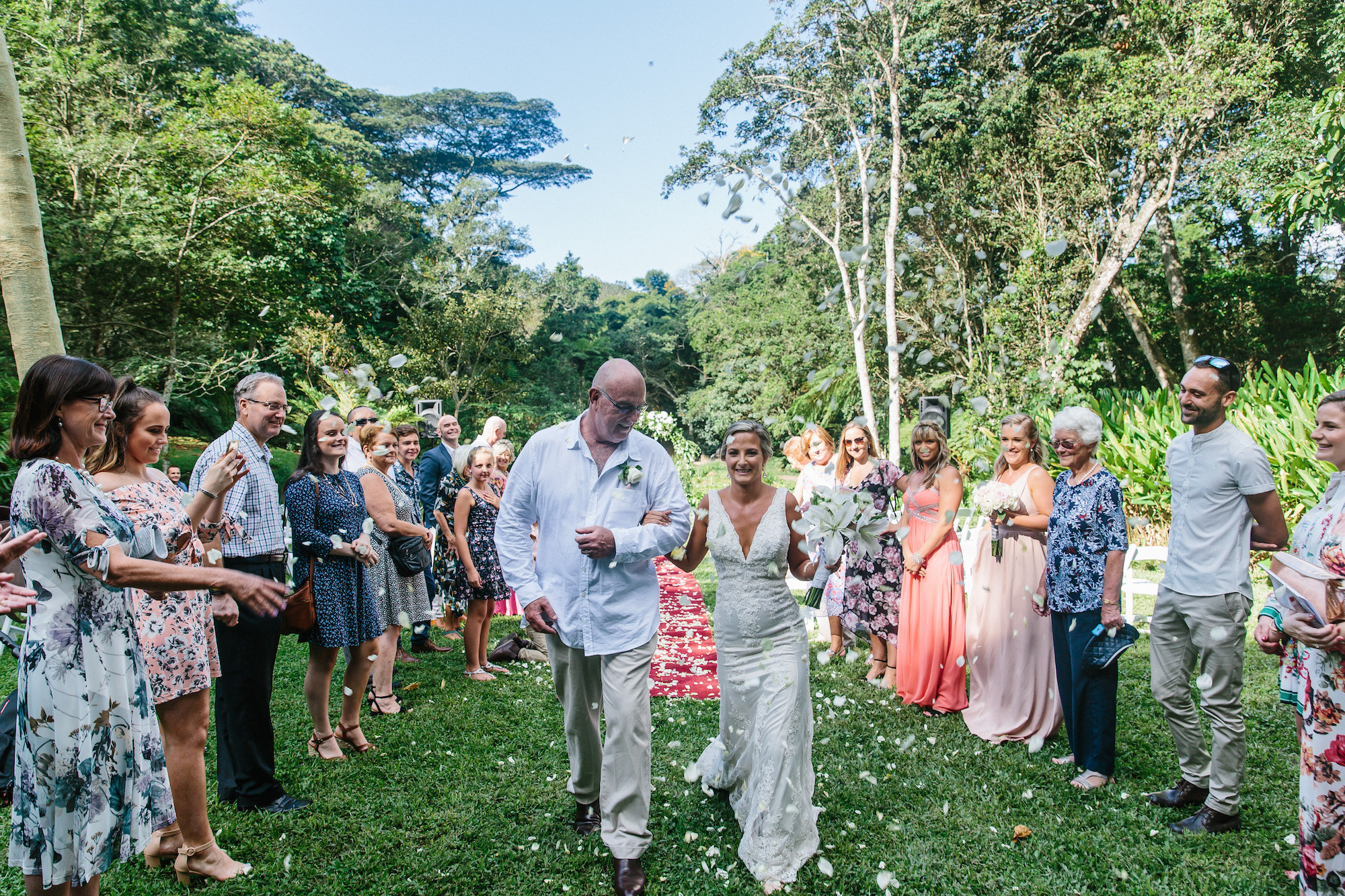 throwing petals on bride and groom