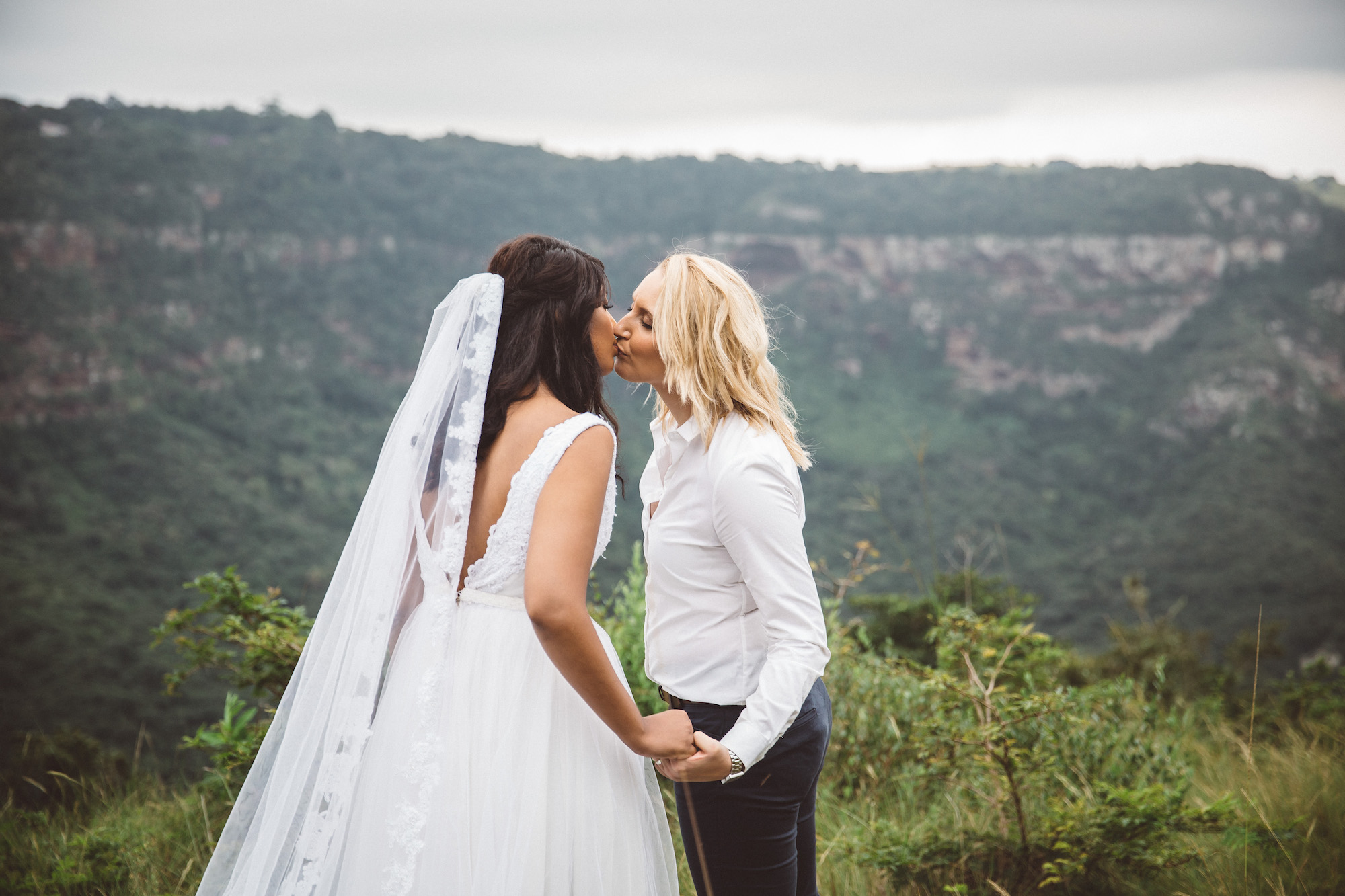 two brides kiss