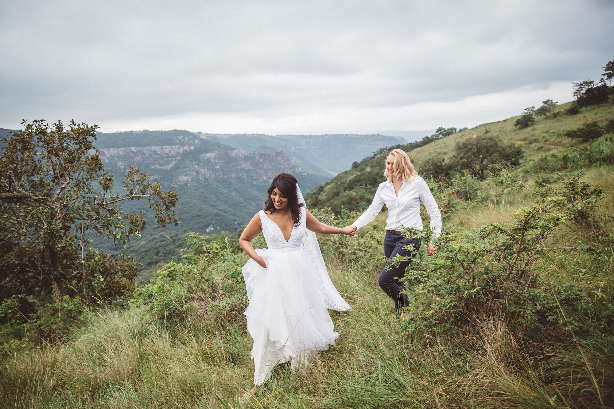 two brides walking in the field