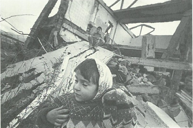 Girl in front of her destroyed school in Spitak. Picture by Jerry Berndt.