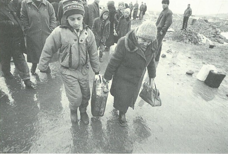 A grandmother and grandson collect fuel in Yerevan.  Picture by Jerry Berndt.