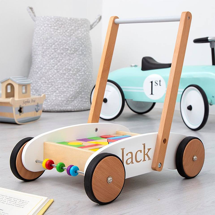 DISCOUNTED PERSONALISED BABY TOYS - Little ones will love this My 1st Years beautifully crafted wooden walker toy completed with multiple colourful wooden blocks. This sensory toy will make a wonderful gift for a little boy or girl, and it can be personalised free of charge with a name of up to 9 characters for an added special touch.