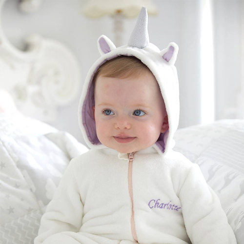 PERSONALISED UNICORN ONESIE - Featuring little fabric unicorn ears and a soft unicorn horn, this super fluffy character onesie will soon become a firm bedtime favourite. Make it extra special by adding personalisation of a name or initials of your choosing.