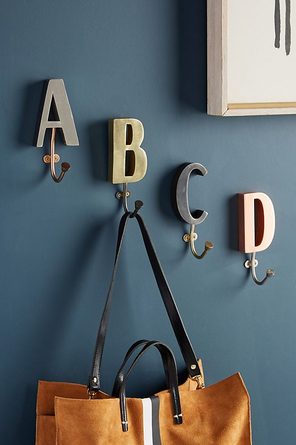 EXCLUSIVE MONOGRAM HOOK NOW £4.95 - If you're looking for a fun way to personalise your home, then why not start with these monogram hooks? They're exclusive to Anthropologie and crafted from durable iron. You're sure to smile everytime you hang your coat on them - simply choose the letter your name begins with.