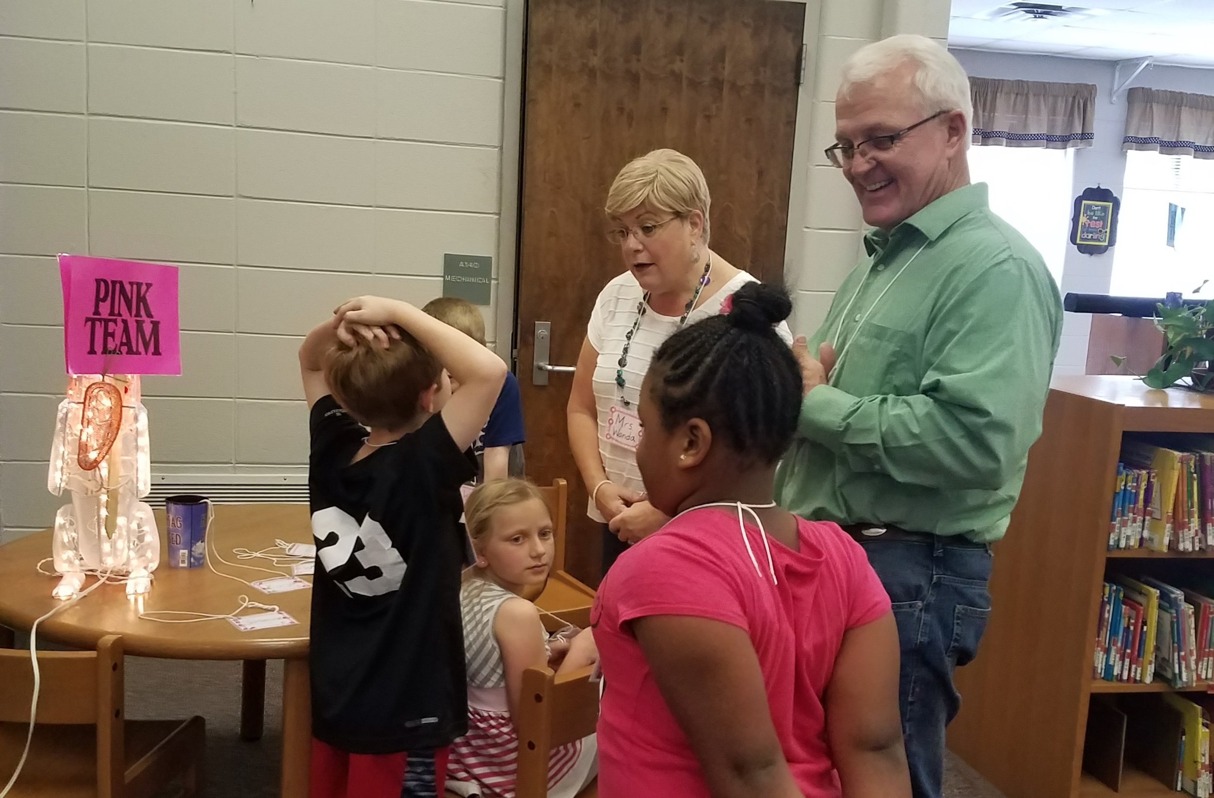 Volunteers welcome students to  Good News Club®  at Coosada Elementary.