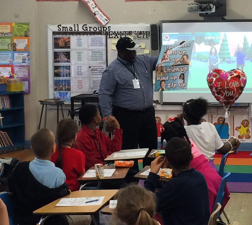 Pastor James Williams of Two Cities Presbyterian Church opens a new  Good News Club® at Floyd Elementary.