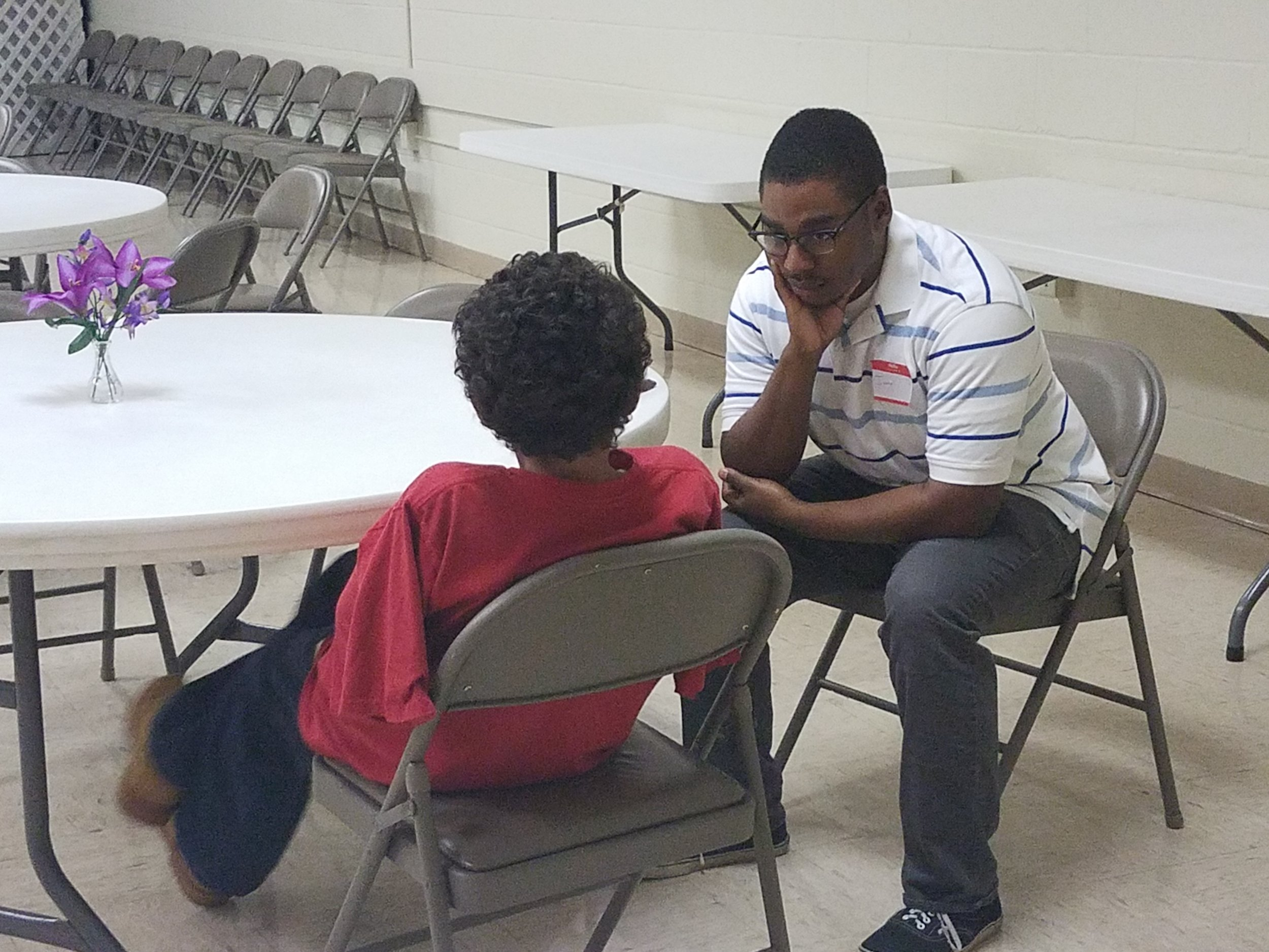 Jamal Frazier build relationship with a young boy in  Good News Club®  partnered with a Single Moms' Ministry at Perry Hill United Methodist Church.