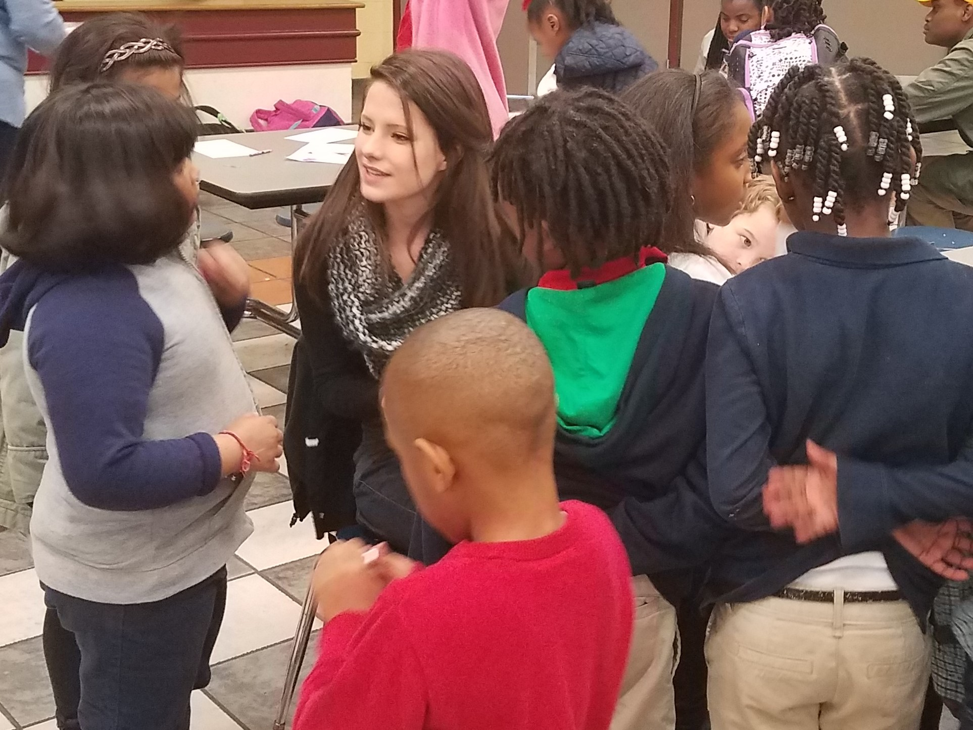 Rebekah Ford listens to children say their memory verses at the Halcyon Elementary  Good News Club® .