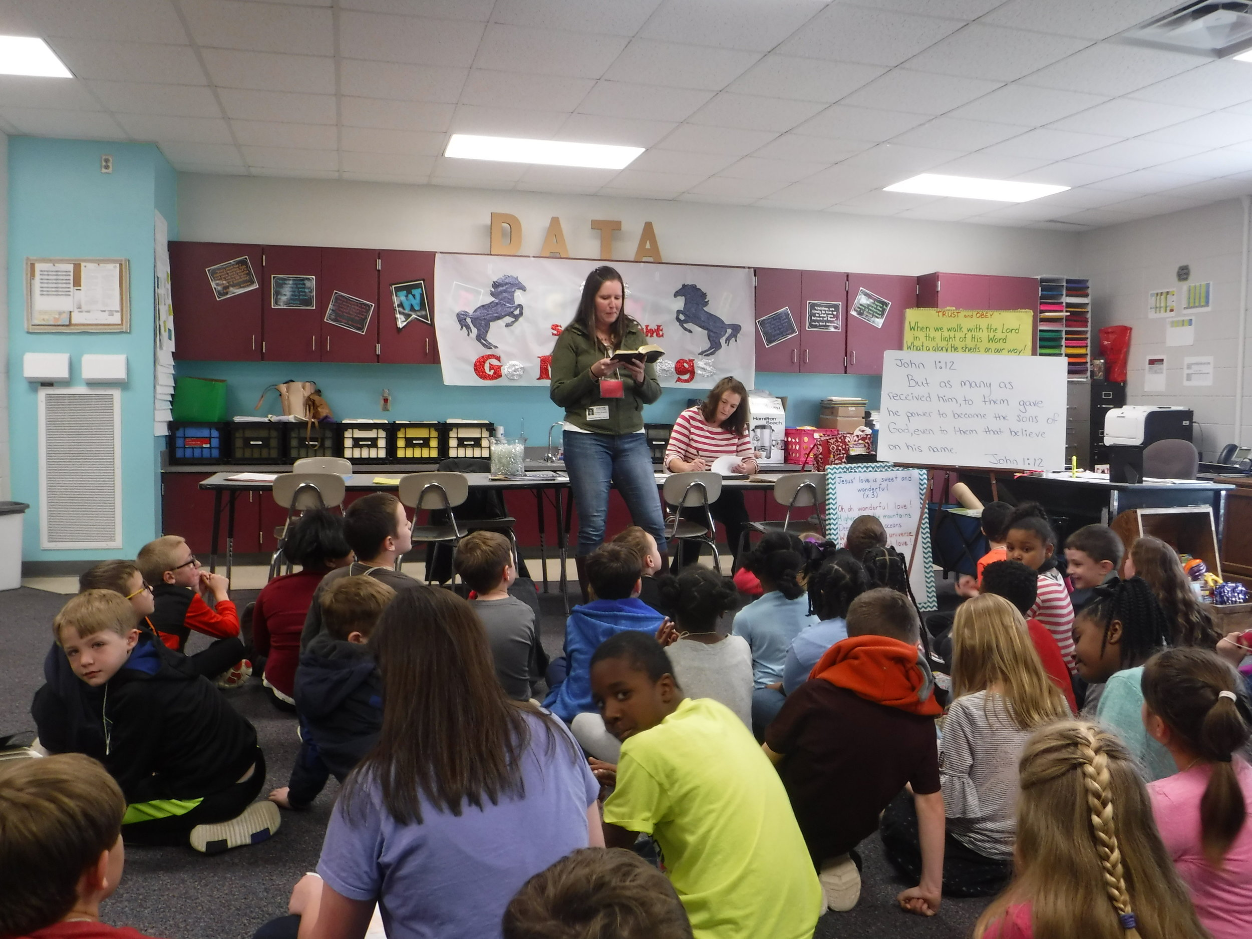 Jessica Bowman teaches a memory verse to students in the Coosada Elementary  Good News Club® .