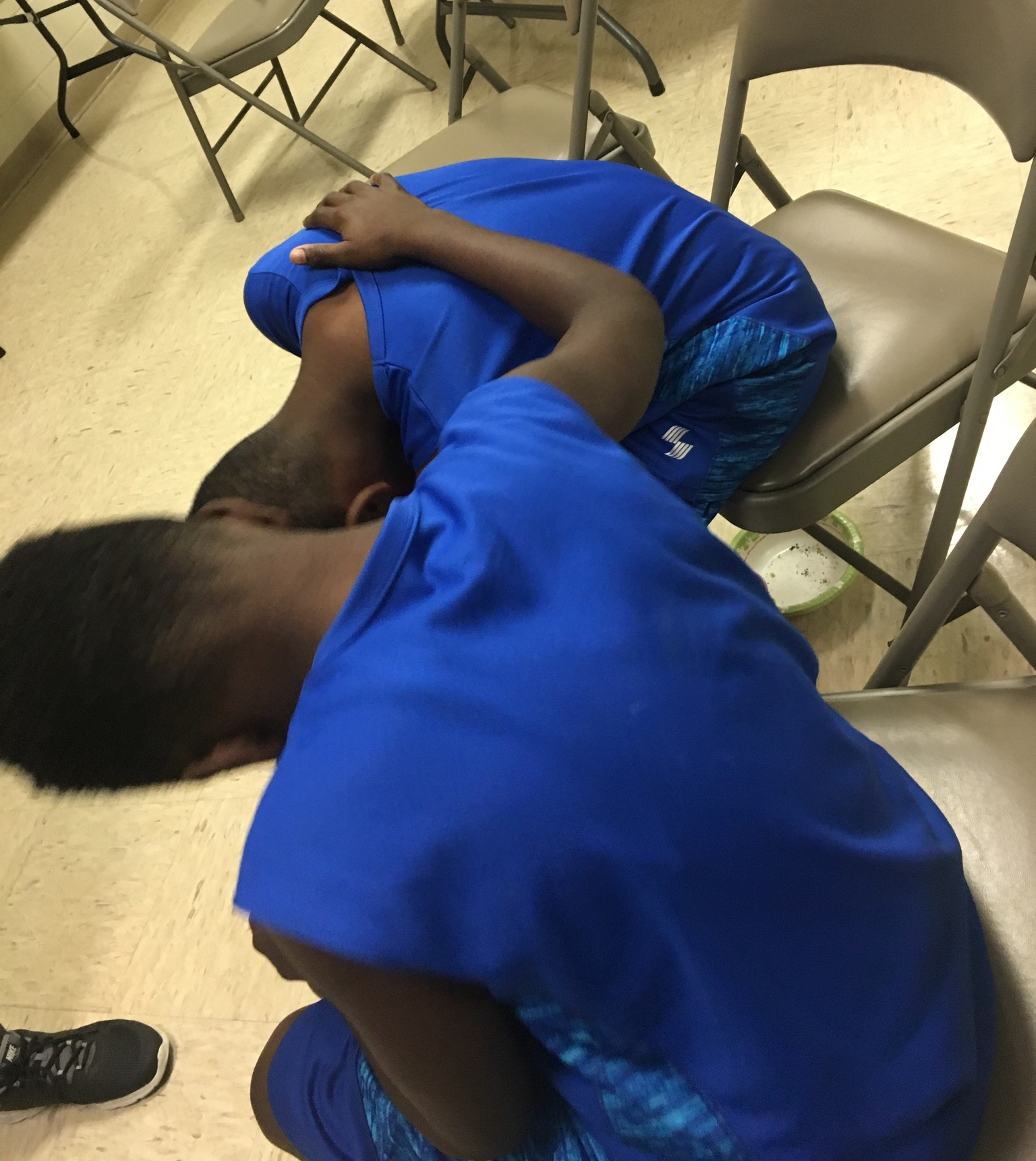 Two brothers pray together at a  Good News Club®  partnered with a Single Moms' ministry at Perry Hill United Methodist Church.
