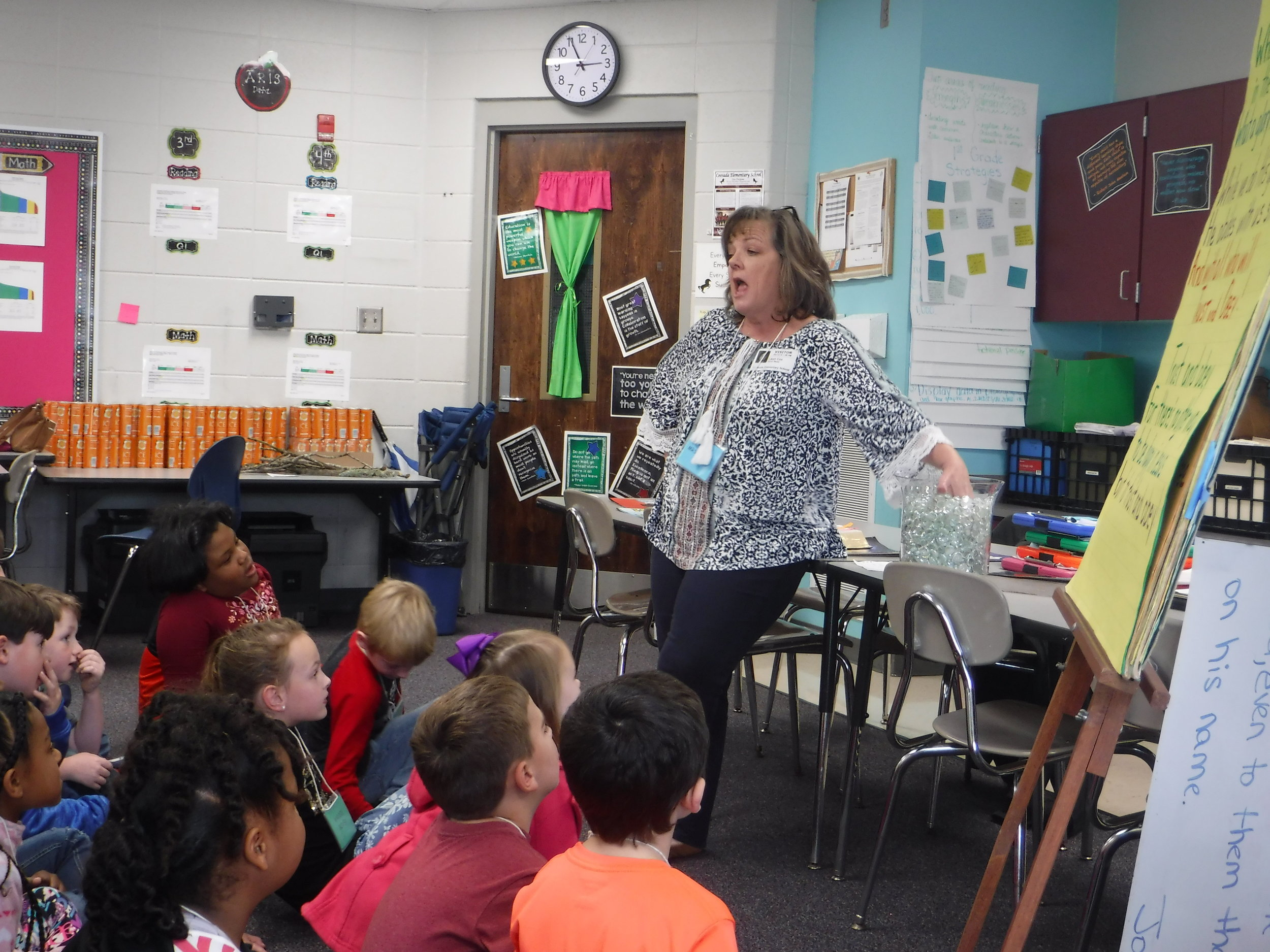 A volunteer teaches about God's omniscience and sovereignty at the Coosada Elementary  Good News Club® .