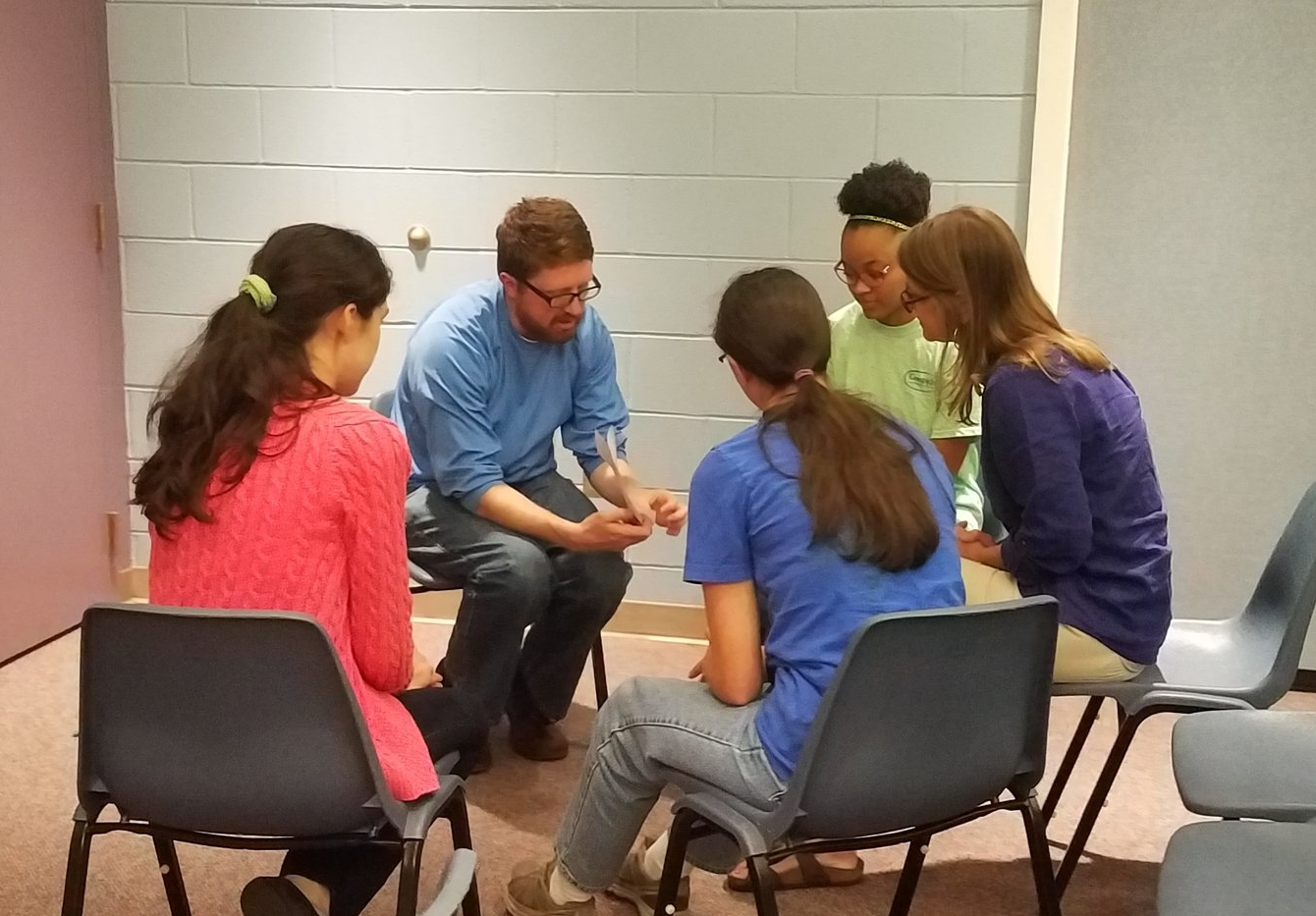 Kelley Herring joins the Young Meadows Presbyterian Summer team in prayer at the annual Summer Church Training.