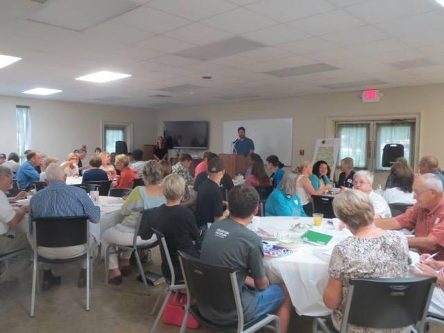 Chris Carver opens  Good News Club®  Training with prayer.