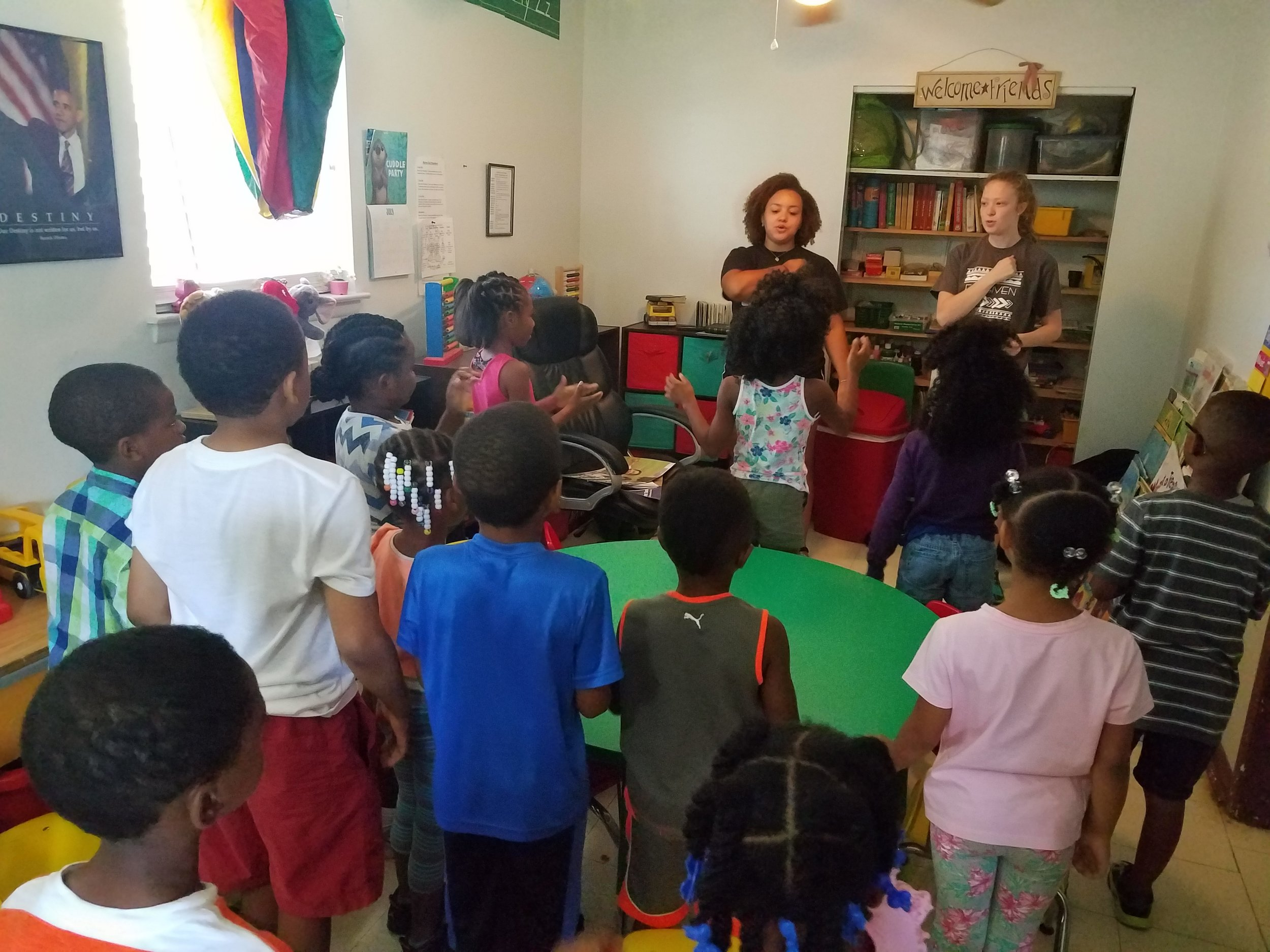 Jade Marcum and Liz Claxton lead music during  5-Day Club®  at Jaad's Daycare in Montgomery, Alabama .