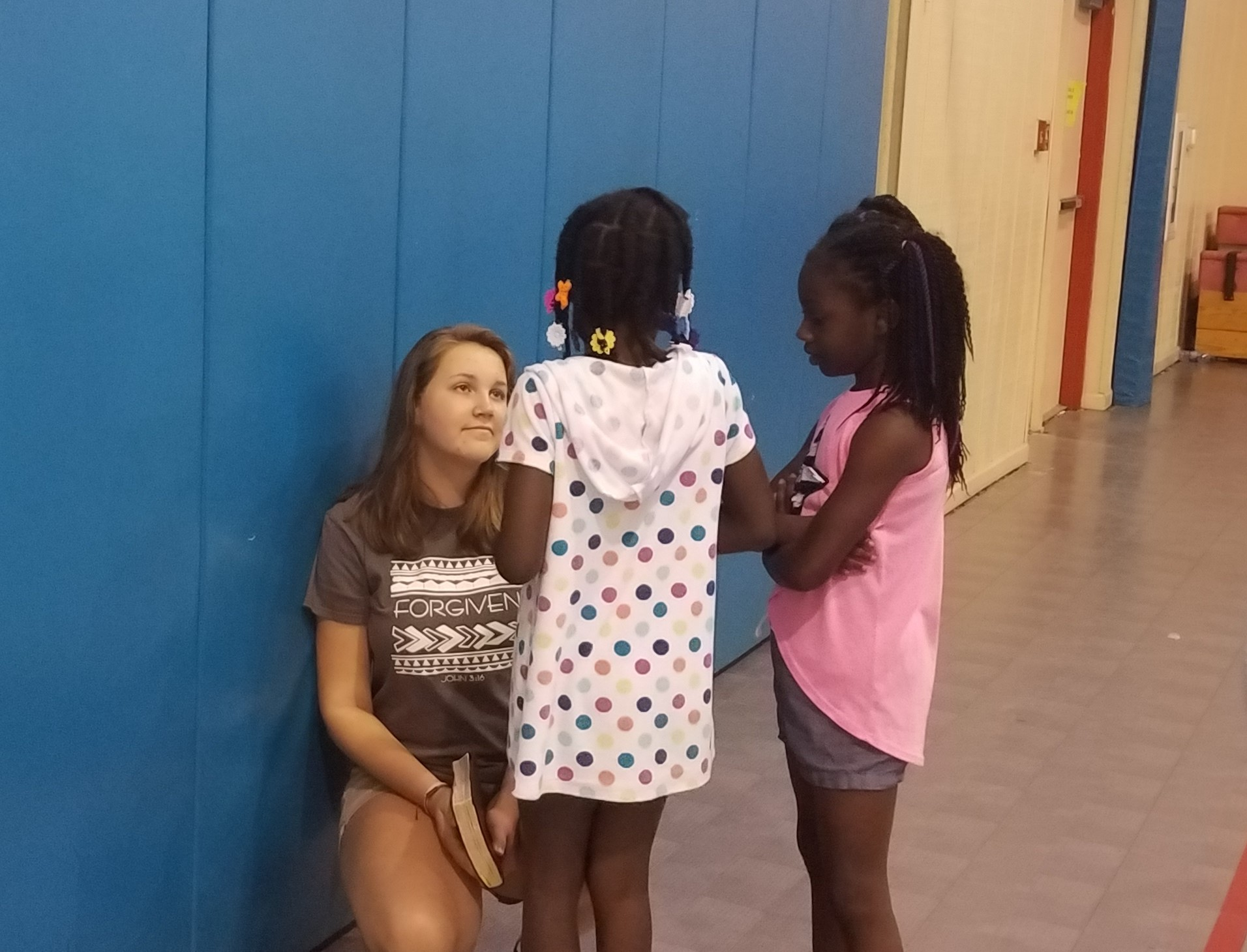 Kate Carver counsels girls after a Bible lesson at a  5-Day Club®  at the Bell Road Good Times Center in Montgomery, Alabama .