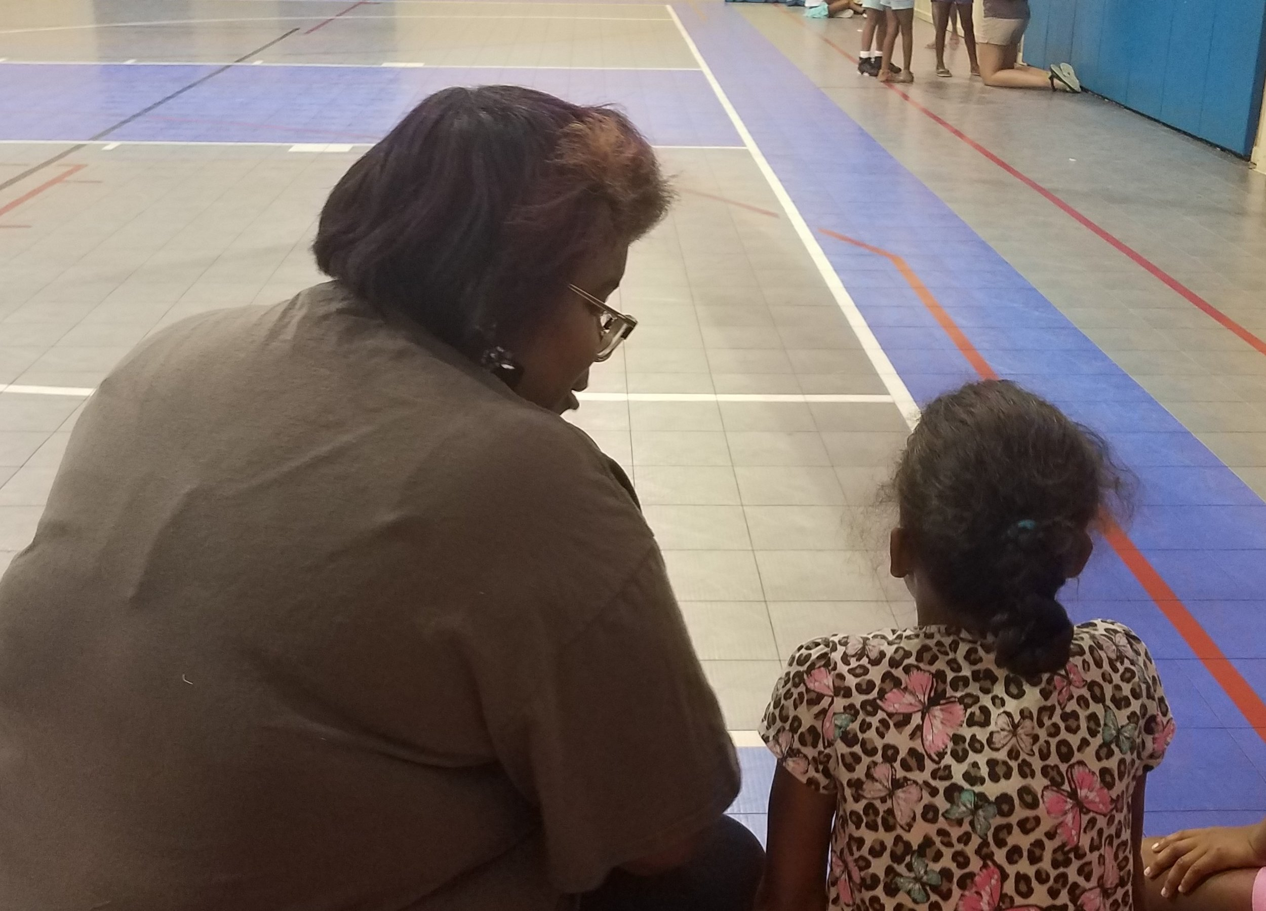 Ruth Barnes counsels a girl after a Bible lesson at a  5-Day Club®  at the Bell Road Goodtimes Center in Montgomery, Alabama.