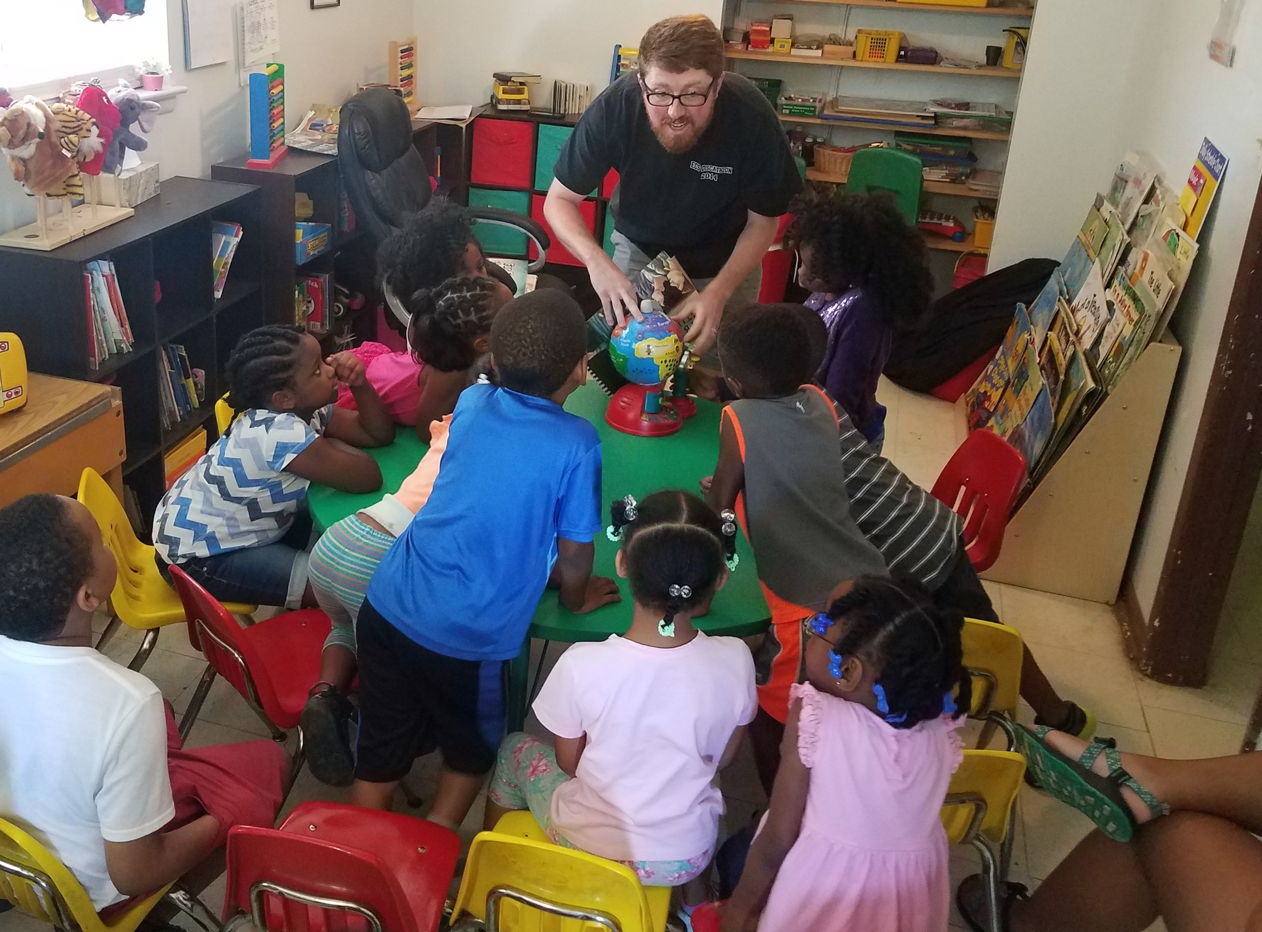 Adam Coppock of Young Meadows Presbyterian church teaches about missions at a  5-Day Club®  at Jaad's Daycare in partnership with  CEF®  of Central Alabama. .