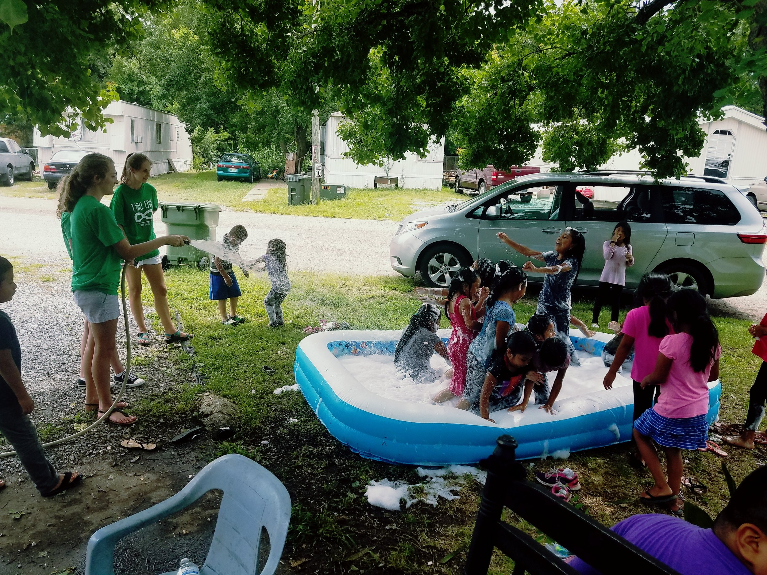 Casey Falcione, of Gateway Baptist Church, and Francie Parker host a water day during  5-Day Club®  at Regency Park in Montgomery, Alabama, as part of partnership between Gateway Baptist and  CEF®  of Central Alabama.