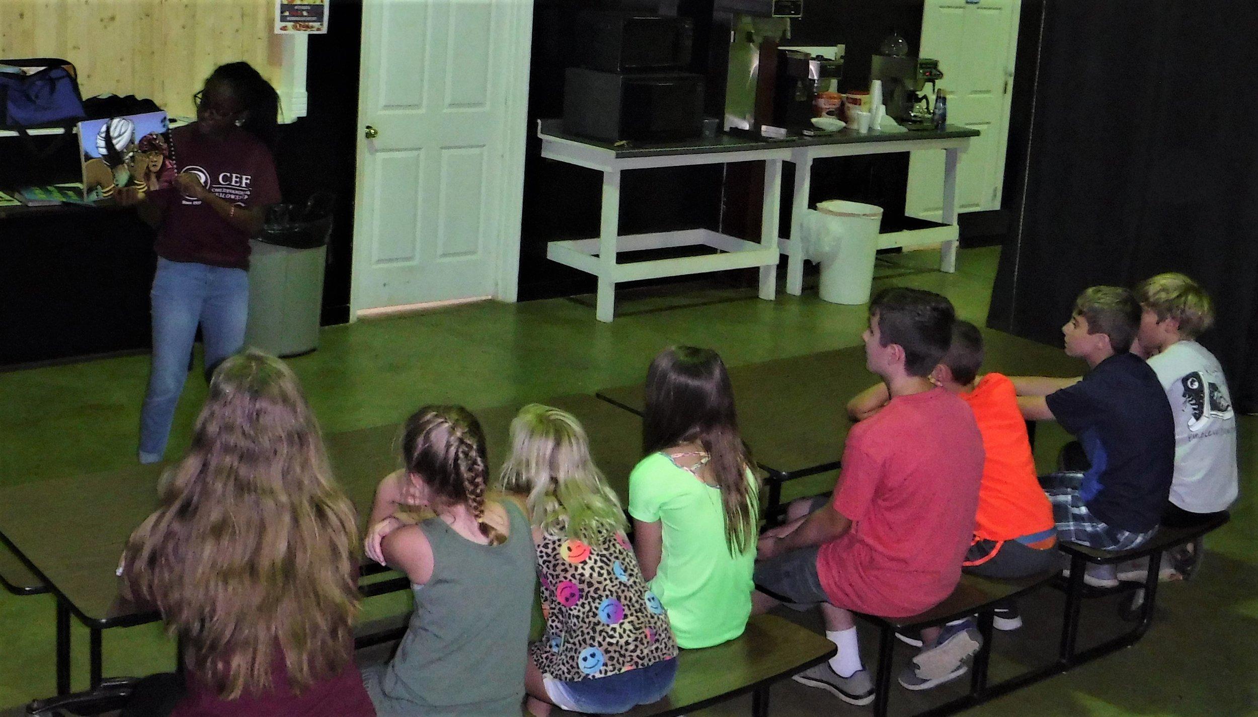 Zaina Marcum, first year, teaches the story of Ringu at training.
