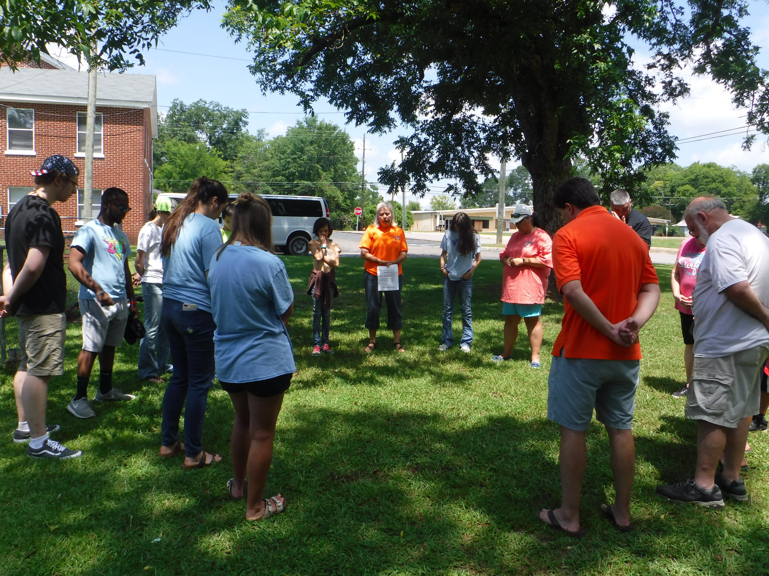 Christian Youth In Action ®  team and First Baptist team pray together before their first day of  5-Day Club®  ministry.