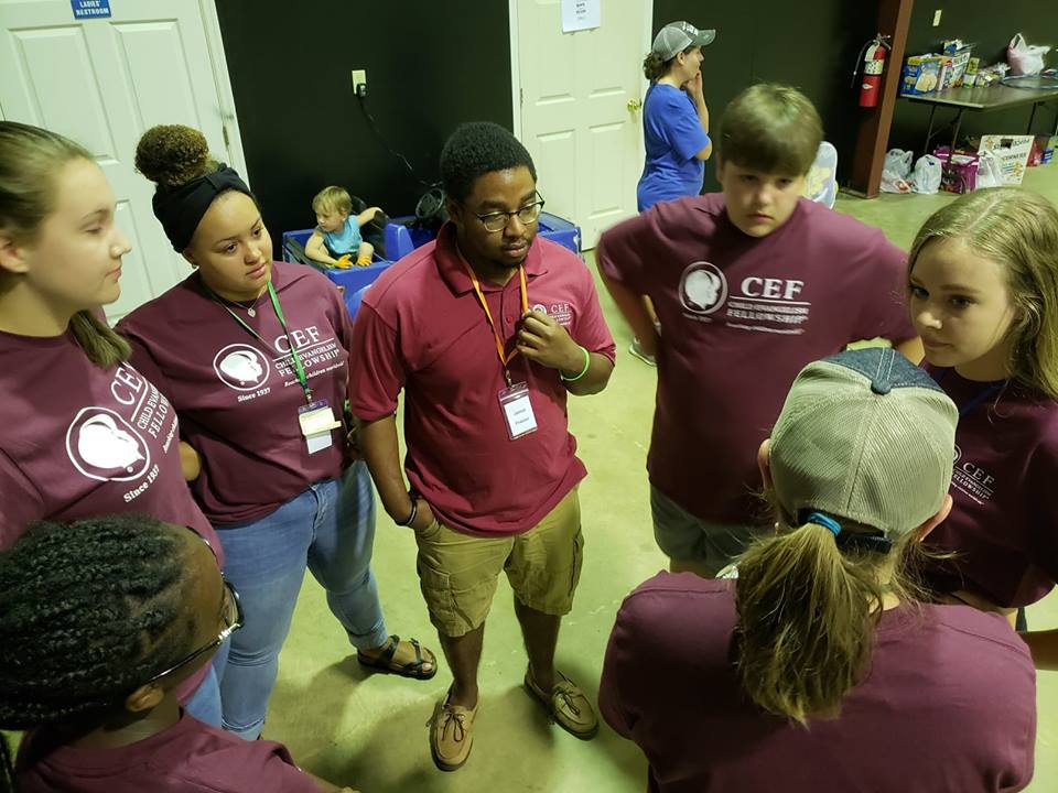 Savannah Barber, Assistant to the Ministry Coordinator, (bottom right corner) helps prep a team for  5-Day Club®  at  CYIA™  training.