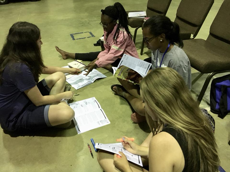 Christian Youth In Action ®  missionaries study for an assignment at training.
