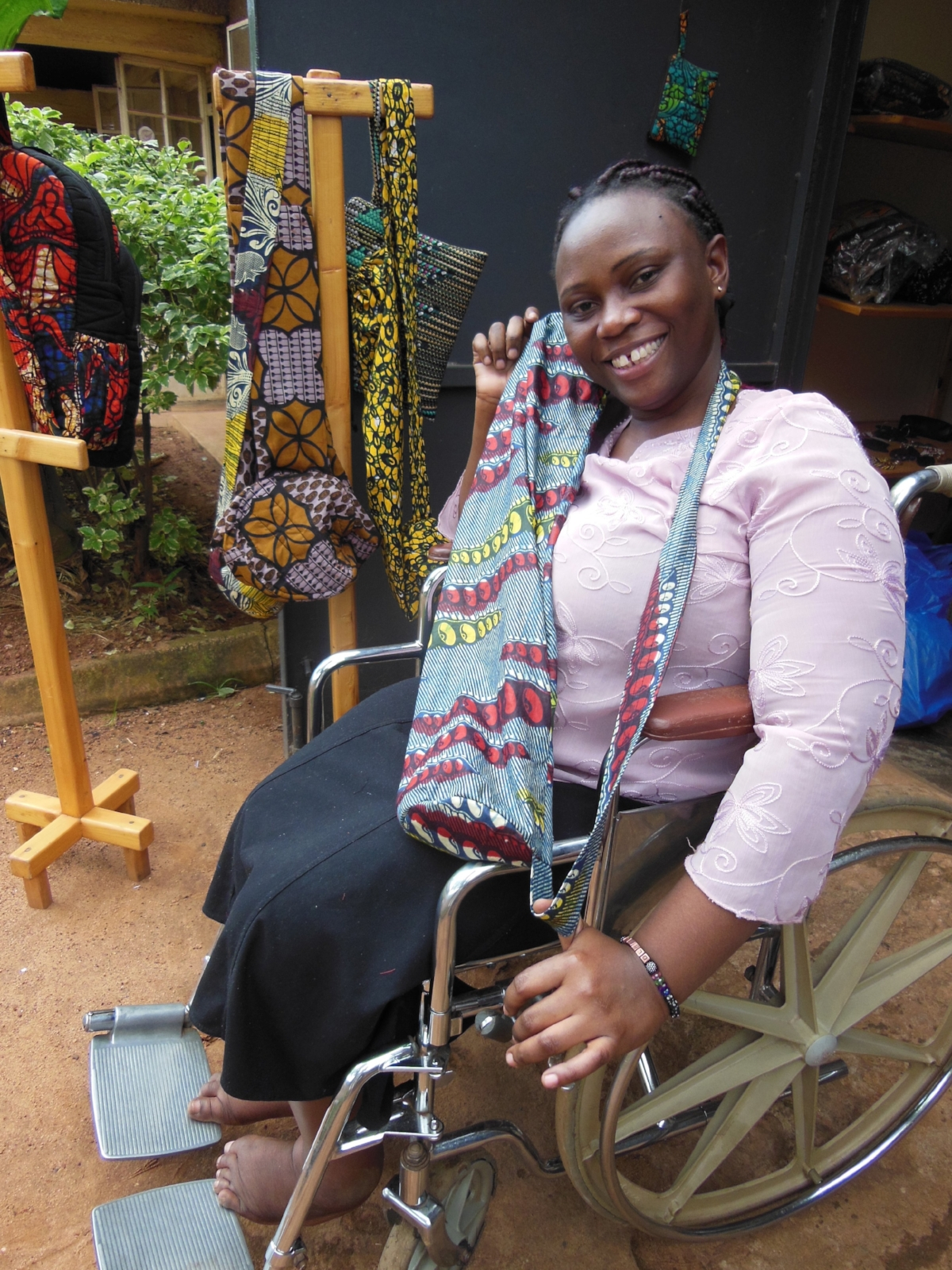 Olivia - Olivia is the founder and head of the Kampala Disabled Initiatives. Like many other women, she was paralysed as a child from polio. She likes sewing yoga mat bags and weekender bags. Her joy is also teaching tailoring to young trainees.