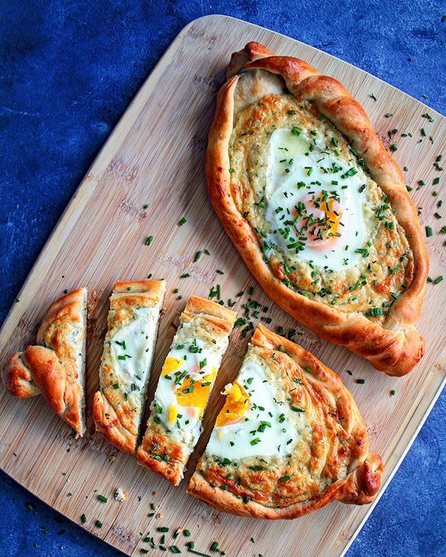 Georgia - Khachapuri, Feast Bread  I've got a different Georgia on my mind today.  This khachapuri is a cheese-filled bread, with a cracked egg on top. It was amazing, but when you have the combination of three different cheeses, you really can't go wrong.  Mozzarella, feta, and ricotta make the PERFECT combination of salty and savory. I did season with a little extra salt, but the saltiness from the feta was so good that it didn't need much extra. Cheese and bread. Cheesy bread. It's just absolutely perfect.  While I'm not much of a baker, nor bread baker for that matter, this is surprisingly simple. It helps that the cheese filling holds its shape pretty well, even while cooking. My favorite part though is tearing off the ends of the khachapuri and dipping it into the cheese. I accidentally over-baked the egg so there was no dipping into that.  Whether you make this or buy this, I highly, highly recommend you guys try it at least once. I took it to a pool party, where people probably wanted to avoid carbs for their pool bodies, and it still got devoured. It made me so happy that my group of friends absolutely loved it.  It also stores really well! Try it.  #whonomstheworld #WNTW #georgia #georgiankhachapuri #khachapuri #globaleats #healthyish #bread #eatingaroundtheworld #storyofmytable #bake #foodstyling #eeeeeats #mycommontable #foodblogfeed #tastingtable #eatingtheworld #foodphotography #food #foodporn #thefeedfeed #atlantablogger #foodblogger #slovakblogger #food4thought #eatprettythings #f52grams #foodgram #homemade @kingarthurflour