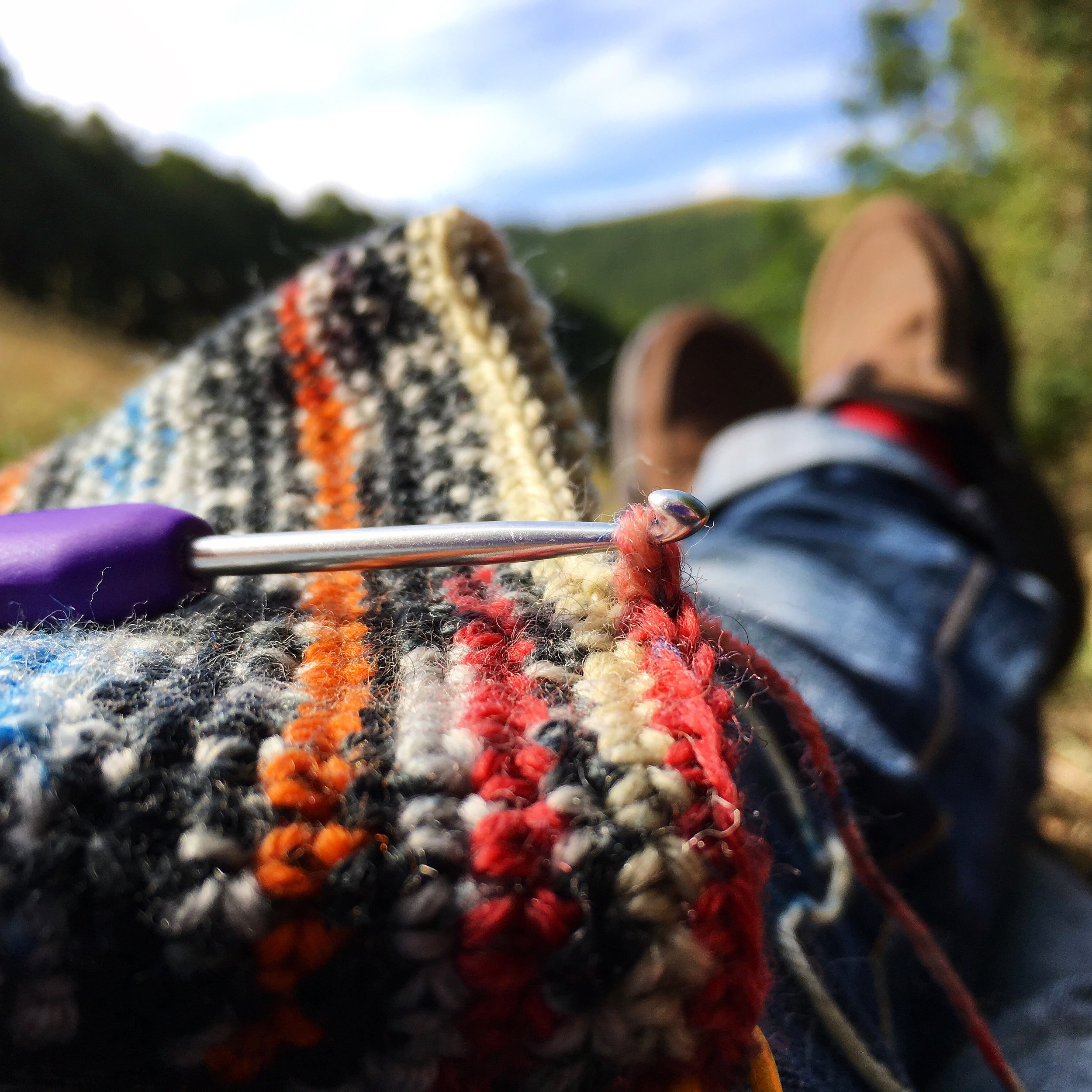Crocheting in a sunny field