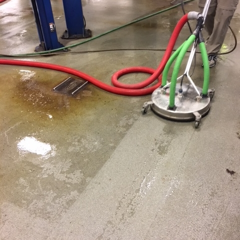 Zeroclene non-detergent cleaner removes tough grease from car dealership floor.