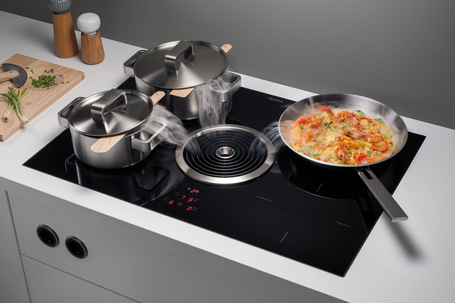 BORA Classic, BORA Basic, or BORA Professional - The BORA cooktop is heralding the end of the extractor hood - a compact system for any kitchen, and revolutionises behaviour in the kitchen.